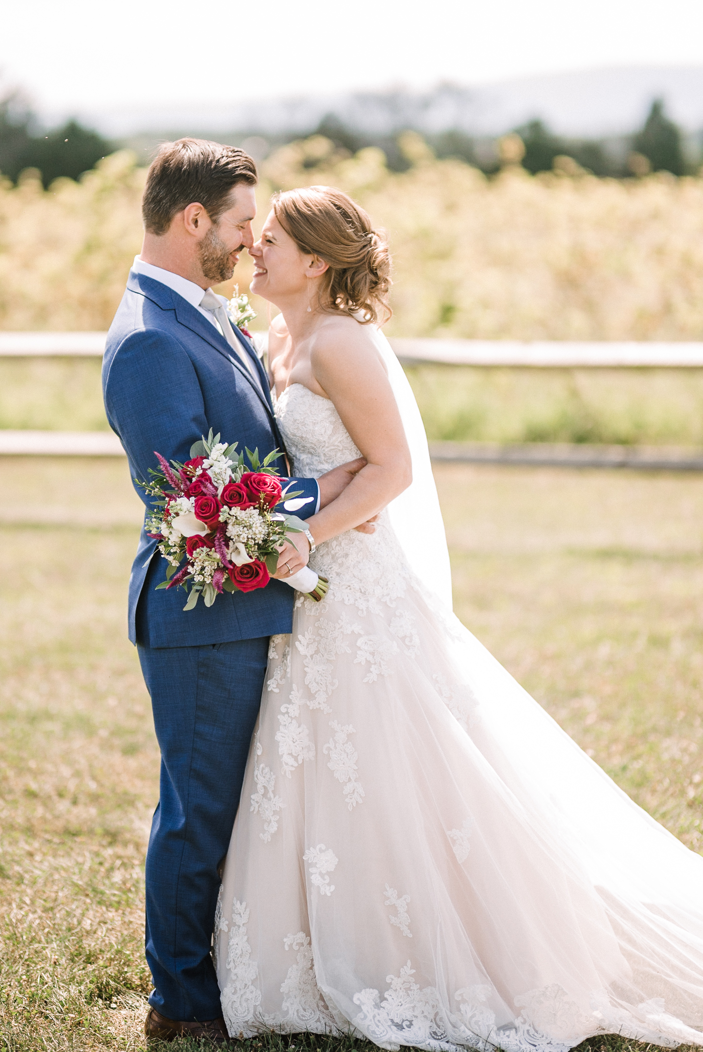 bride and groom embracing at Faithbrooke Barn & Vineyards