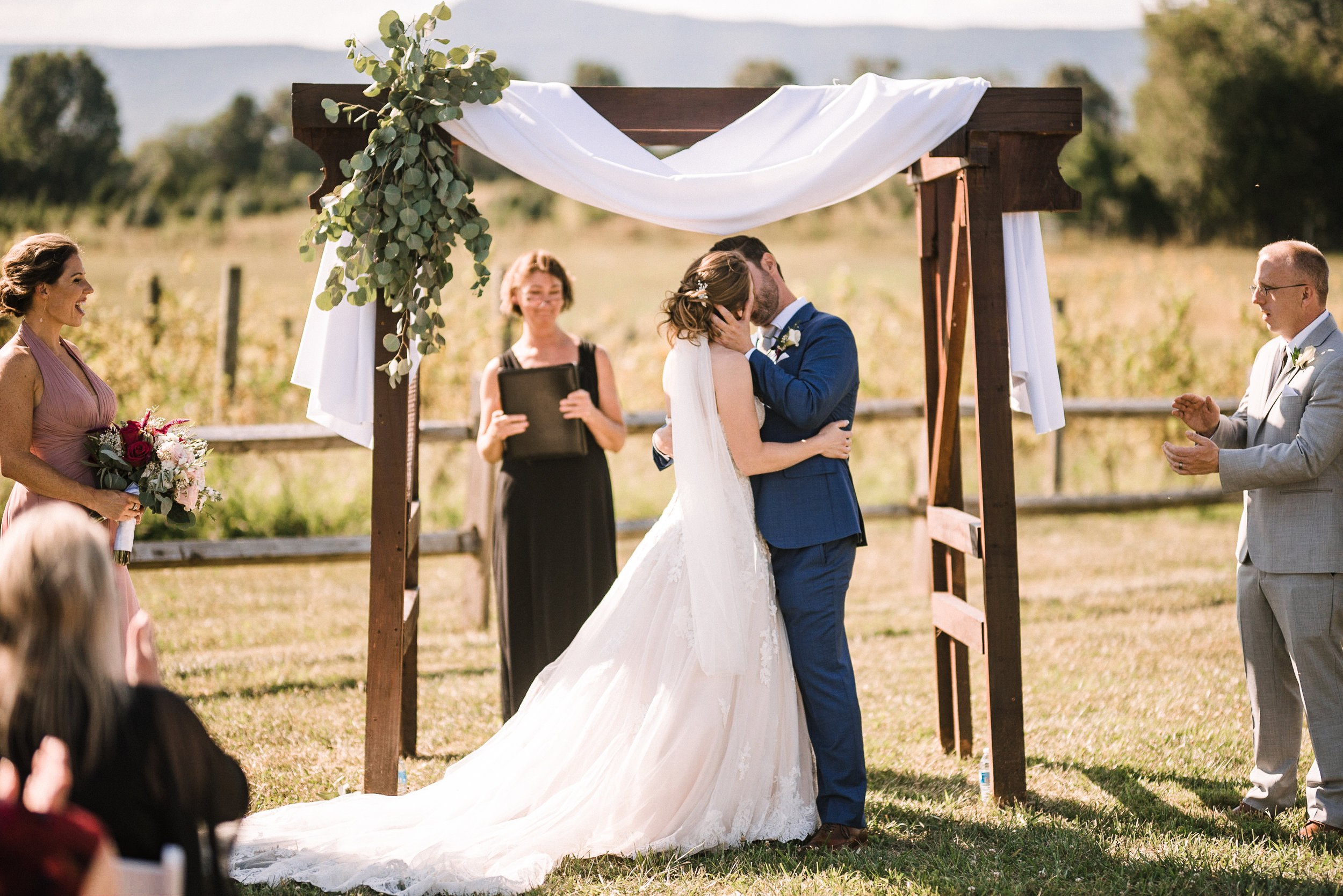 bride and groom kissing during ceremony at Faithbrooke Barn & Vineyards