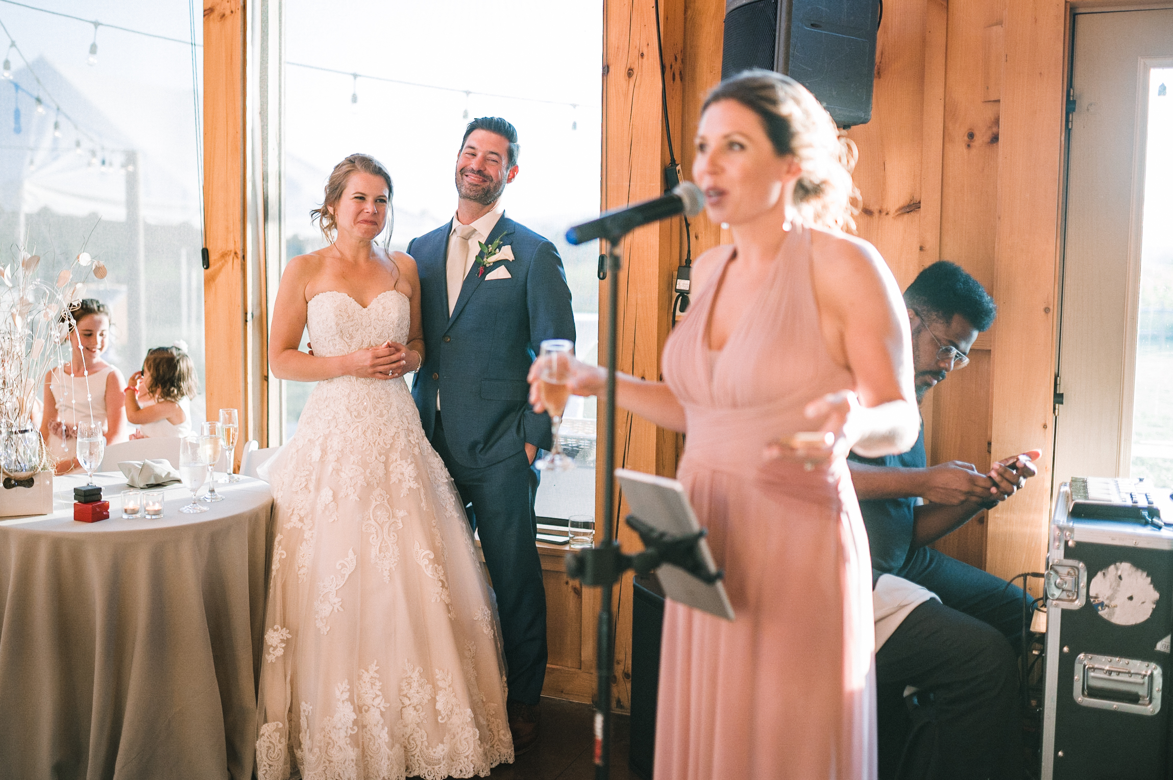 bride and groom listening to maid of honor's speech at Faithbrooke Barn & Vineyards