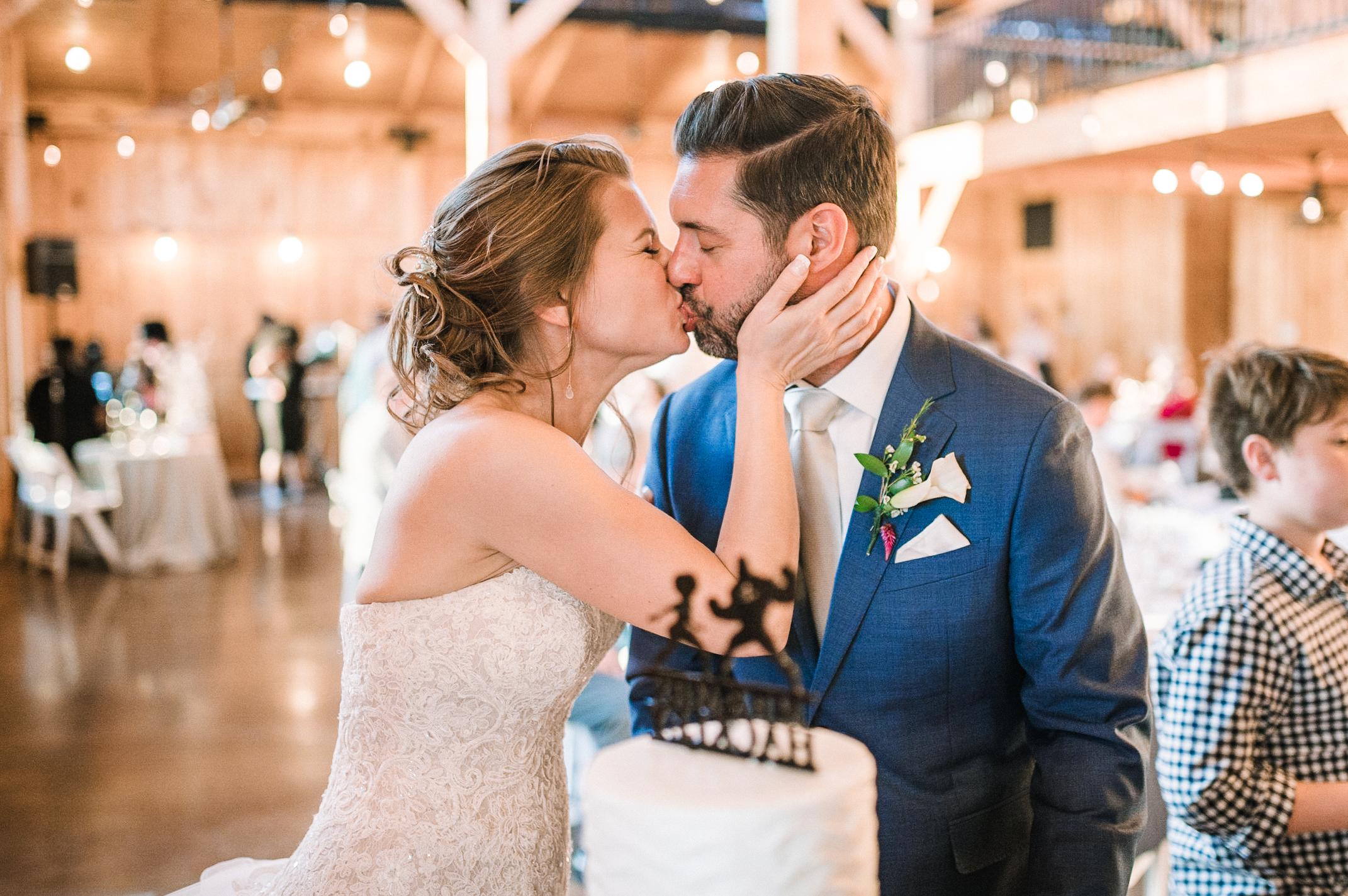 bride and groom kissing at reception at Faithbrooke Barn & Vineyards
