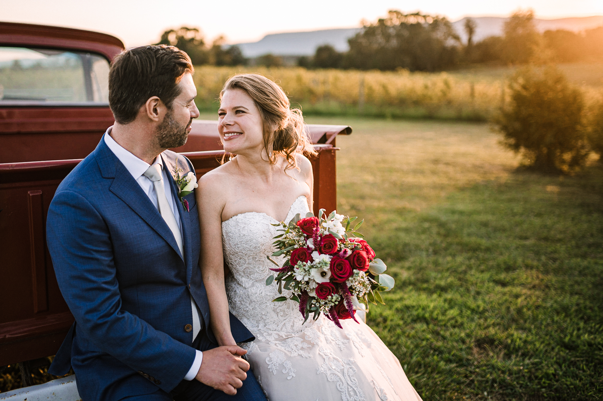 bride and groom smiling at each other at Faithbrooke Barn & Vineyards