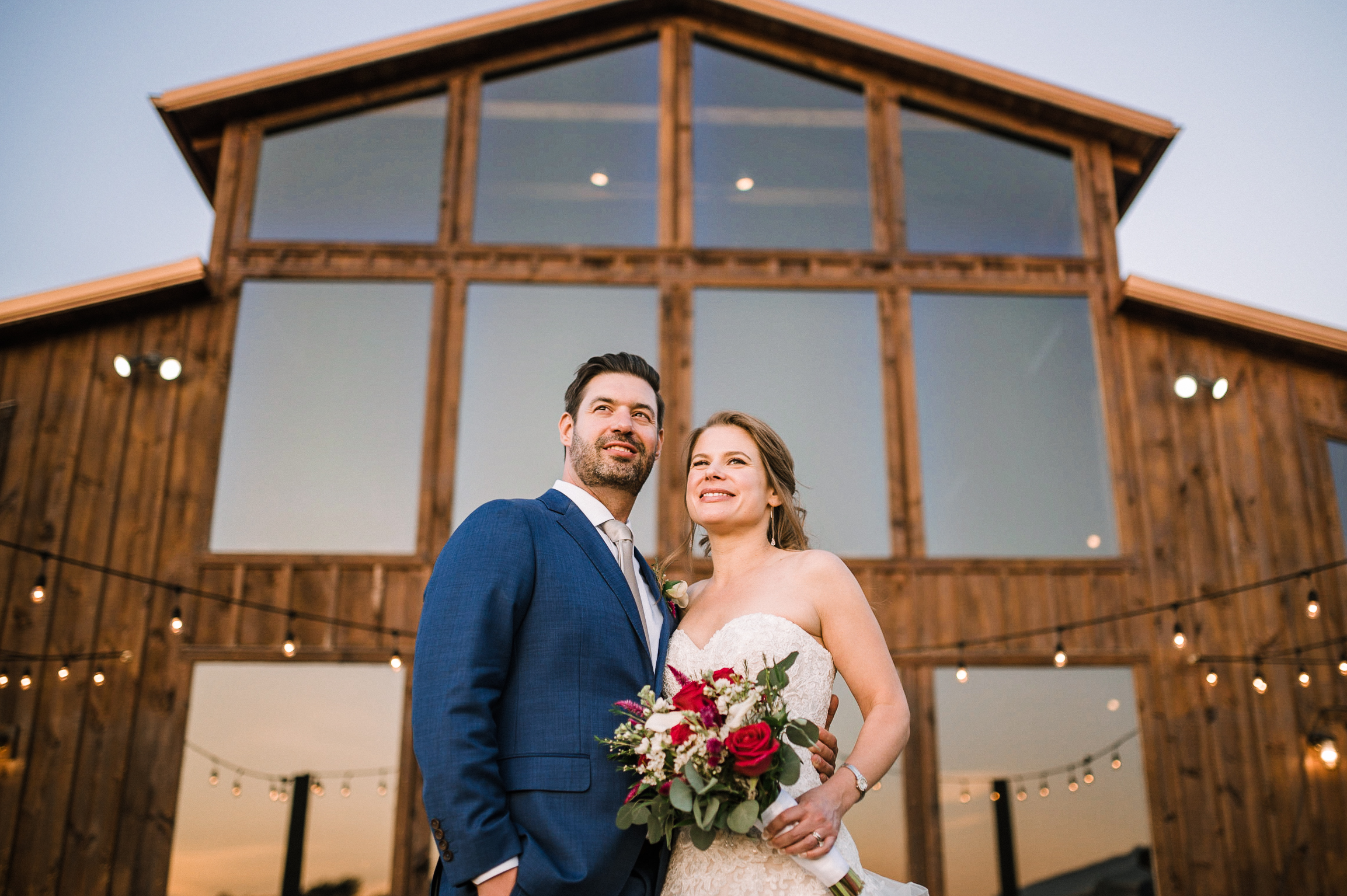 bride and groom smiling at Faithbrooke Barn & Vineyards