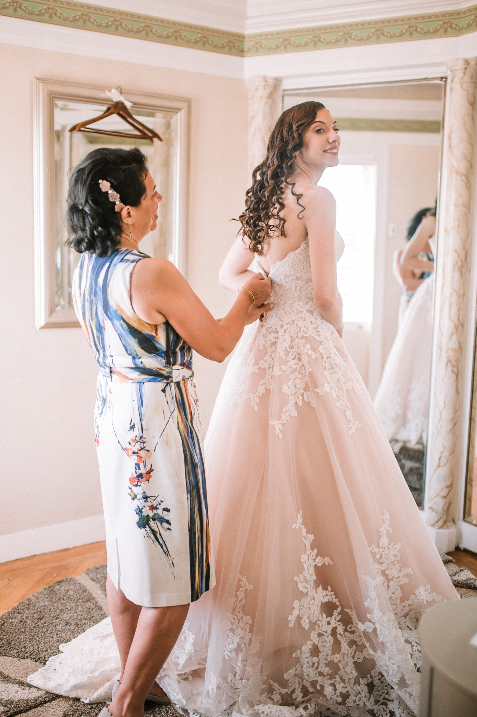 bride getting into wedding dress at The Newton White Mansion