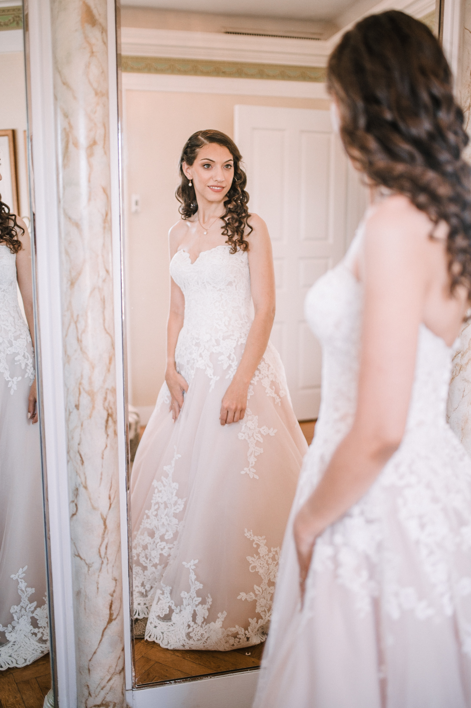 bride looking in mirror at The Newton White Mansion