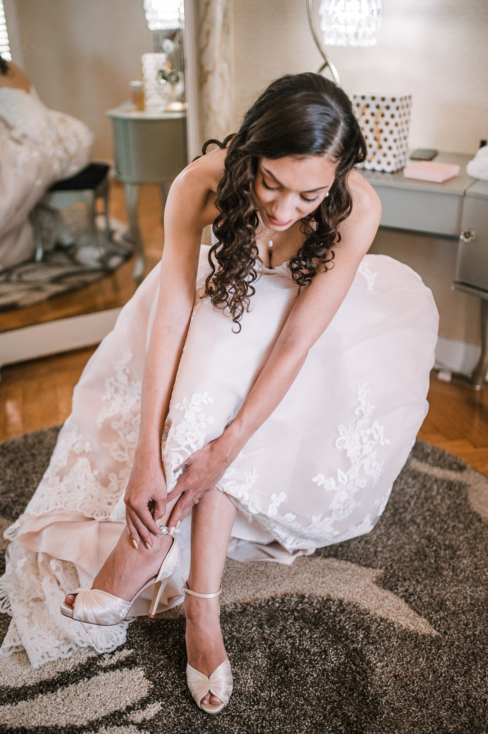 bride putting on shoes at The Newton White Mansion