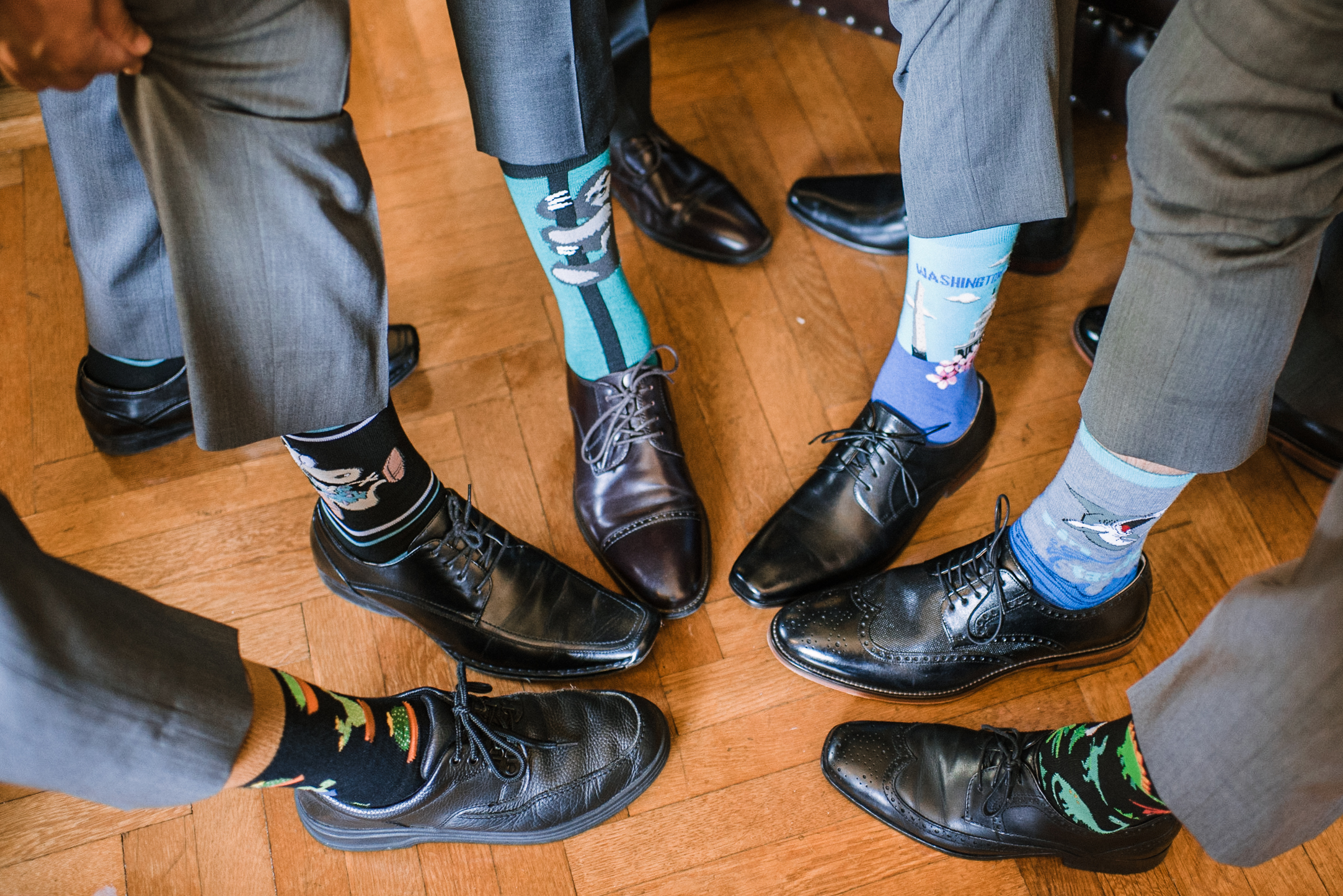 groom and groomsmen showing off socks at The Newton White Mansion