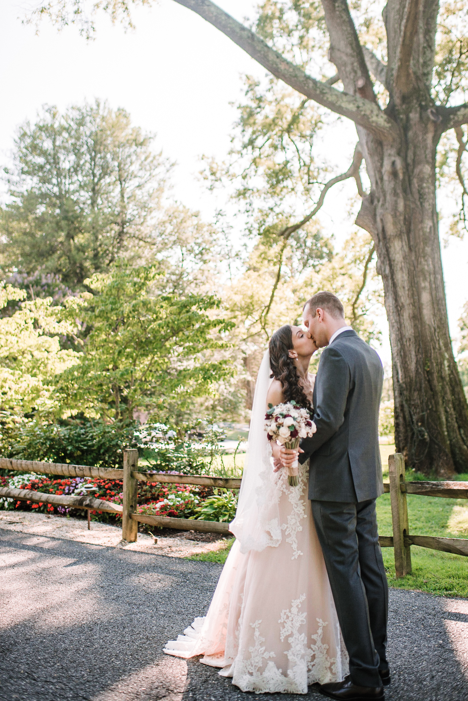 Bride and groom kissing at The Newton White Mansion