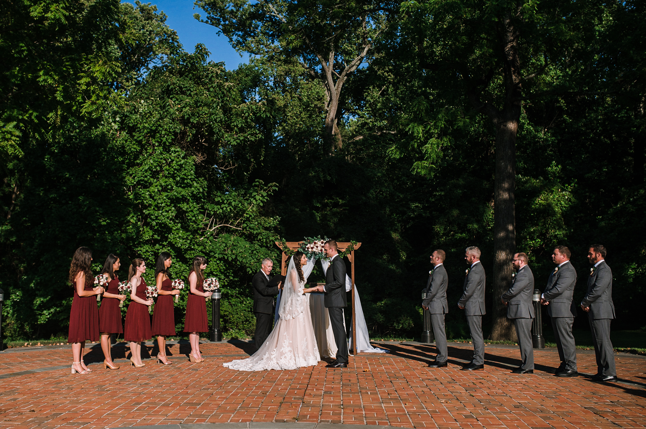 bride and groom at ceremony at The Newton White Mansion