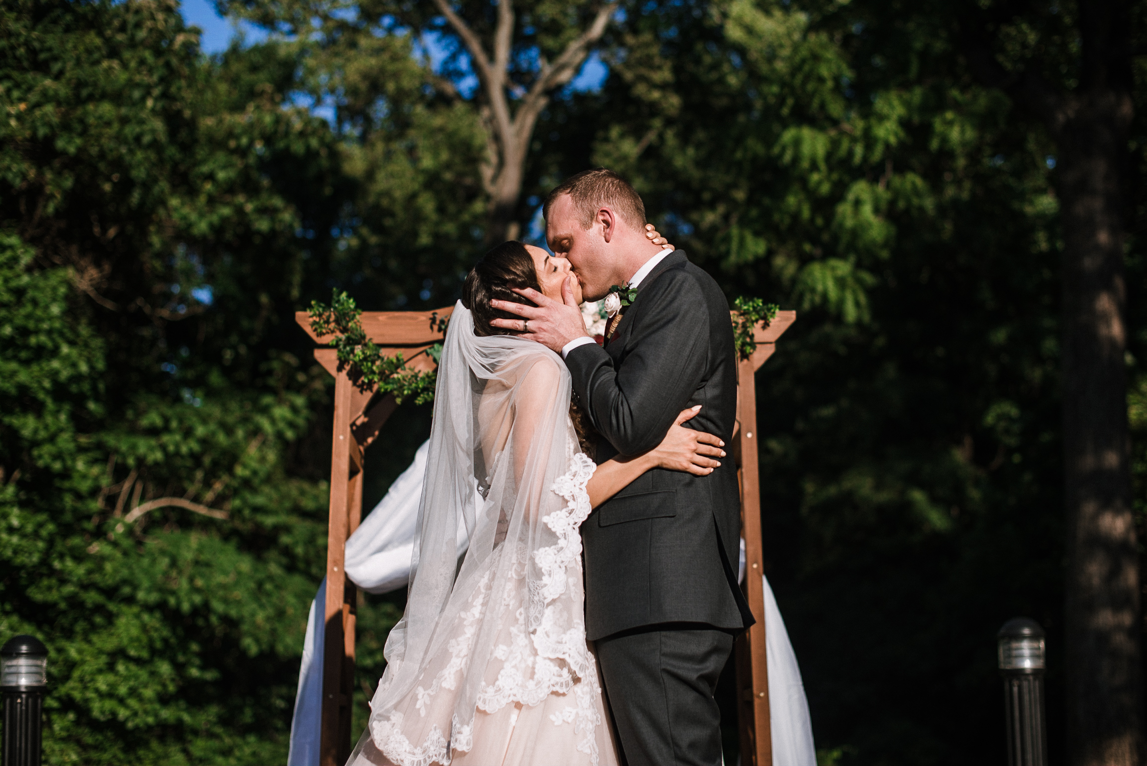 bride and groom kissing during ceremony at The Newton White Mansion