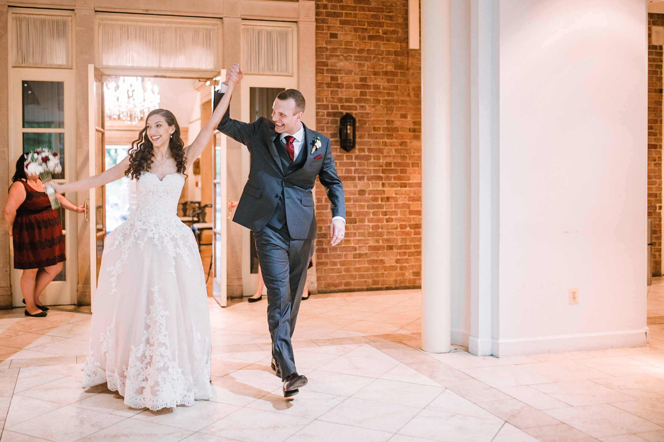 bride and groom entering reception at The Newton White Mansion