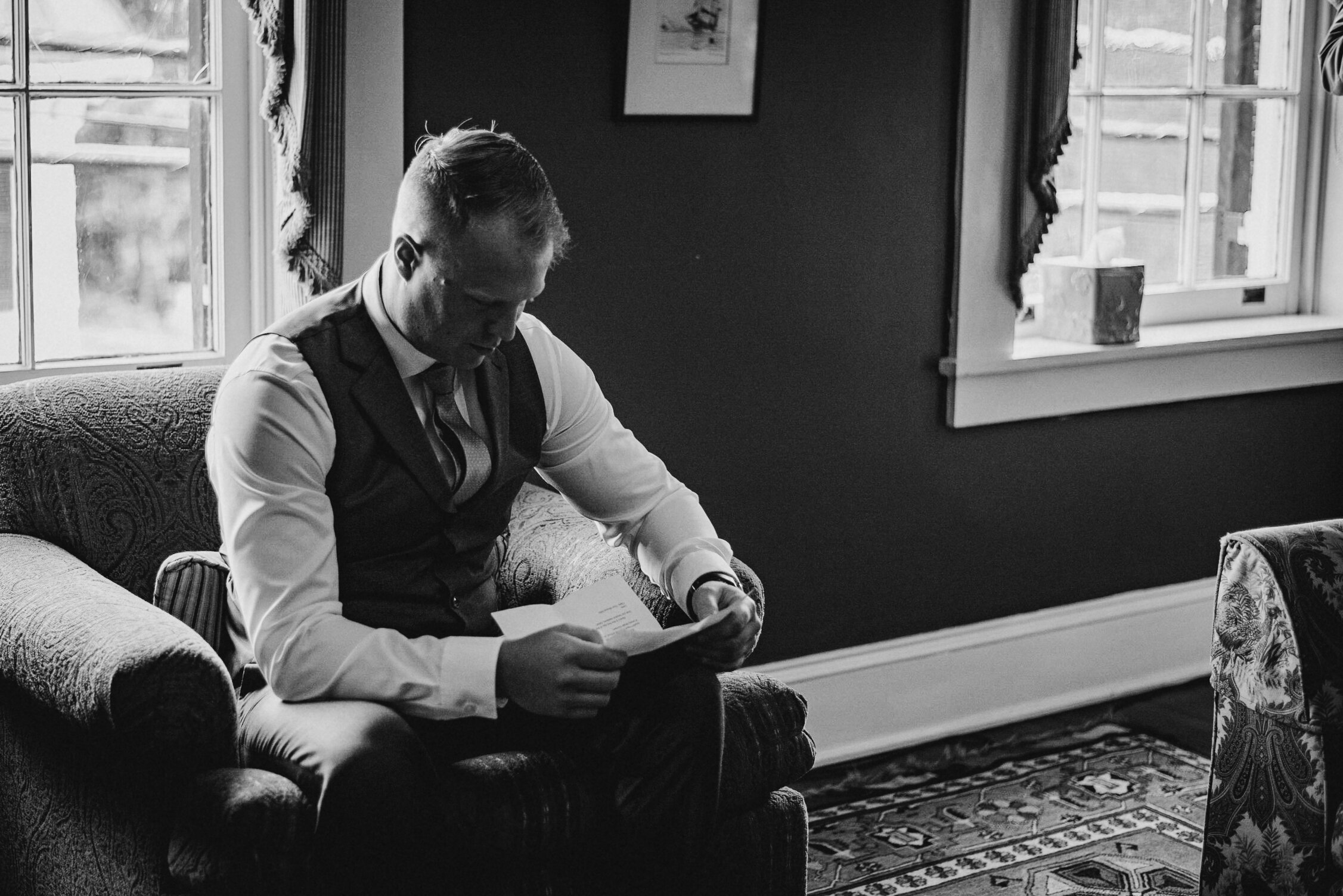 groom reading letter from bride at Birkby House