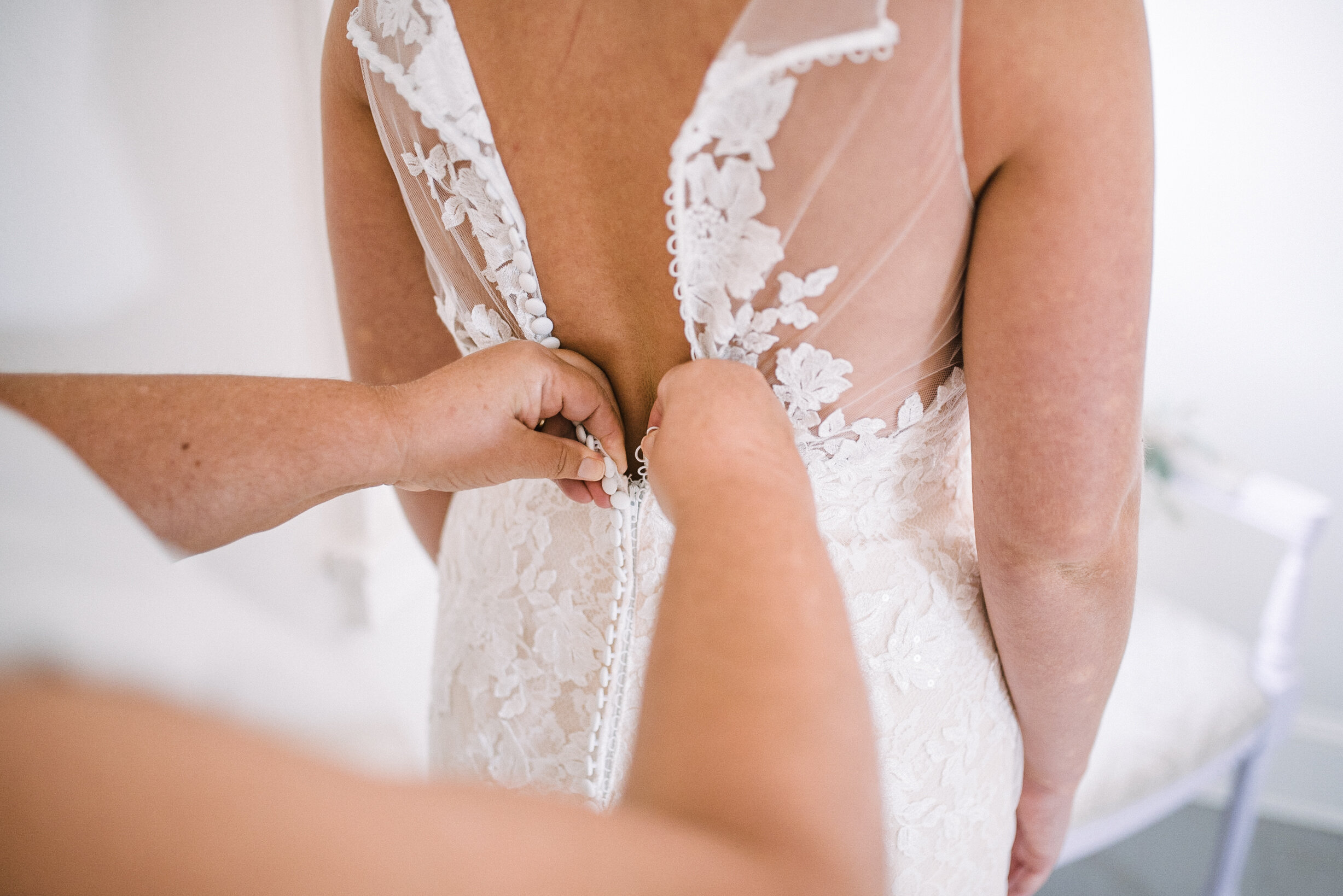 bride getting into wedding dress at Birkby House