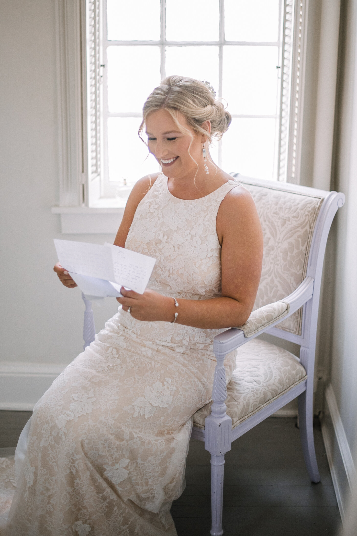 bride reading letter from groom at Birkby House