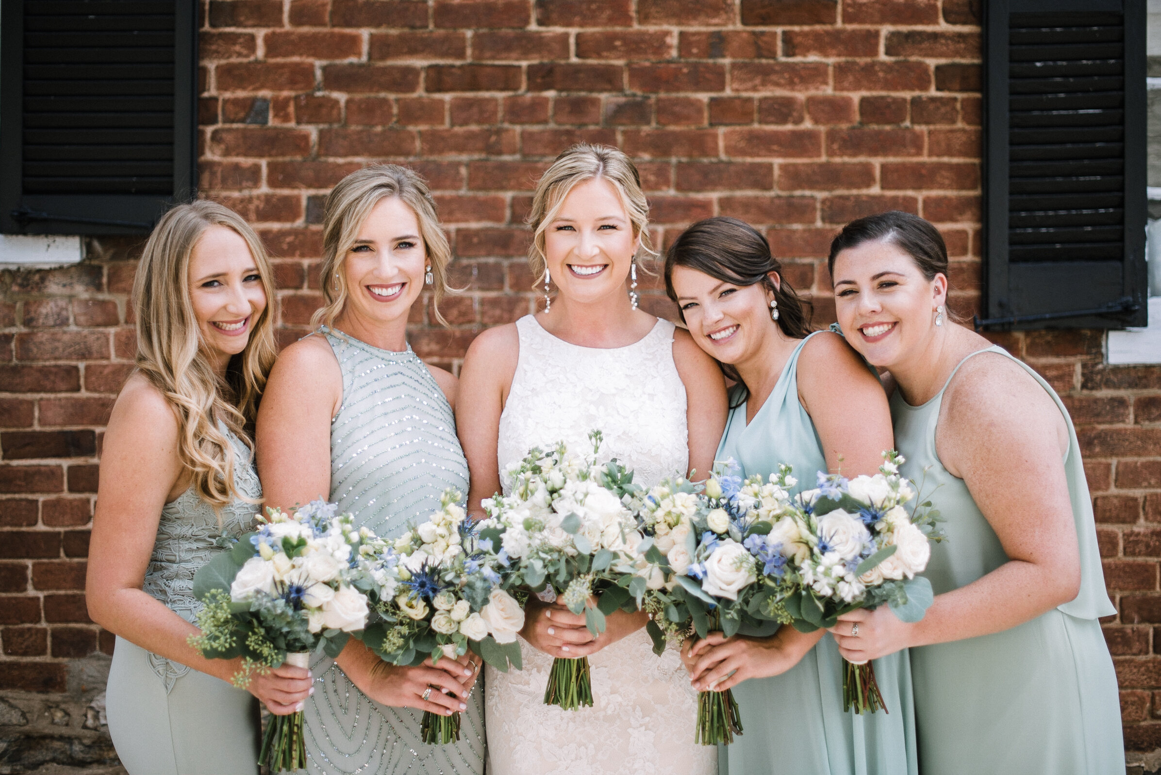 bride and bridesmaids smiling at Birkby House