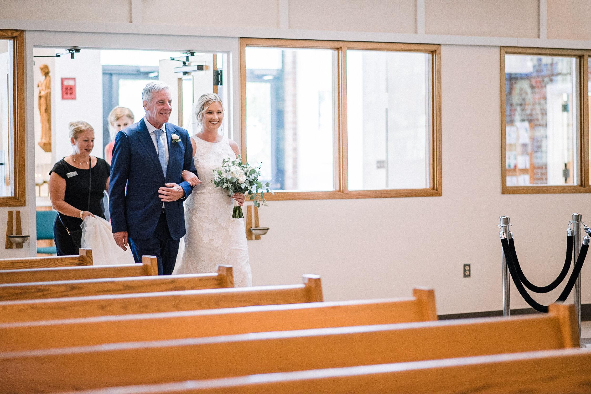 Bride walking down the aisle at St. Joseph Catholic Church
