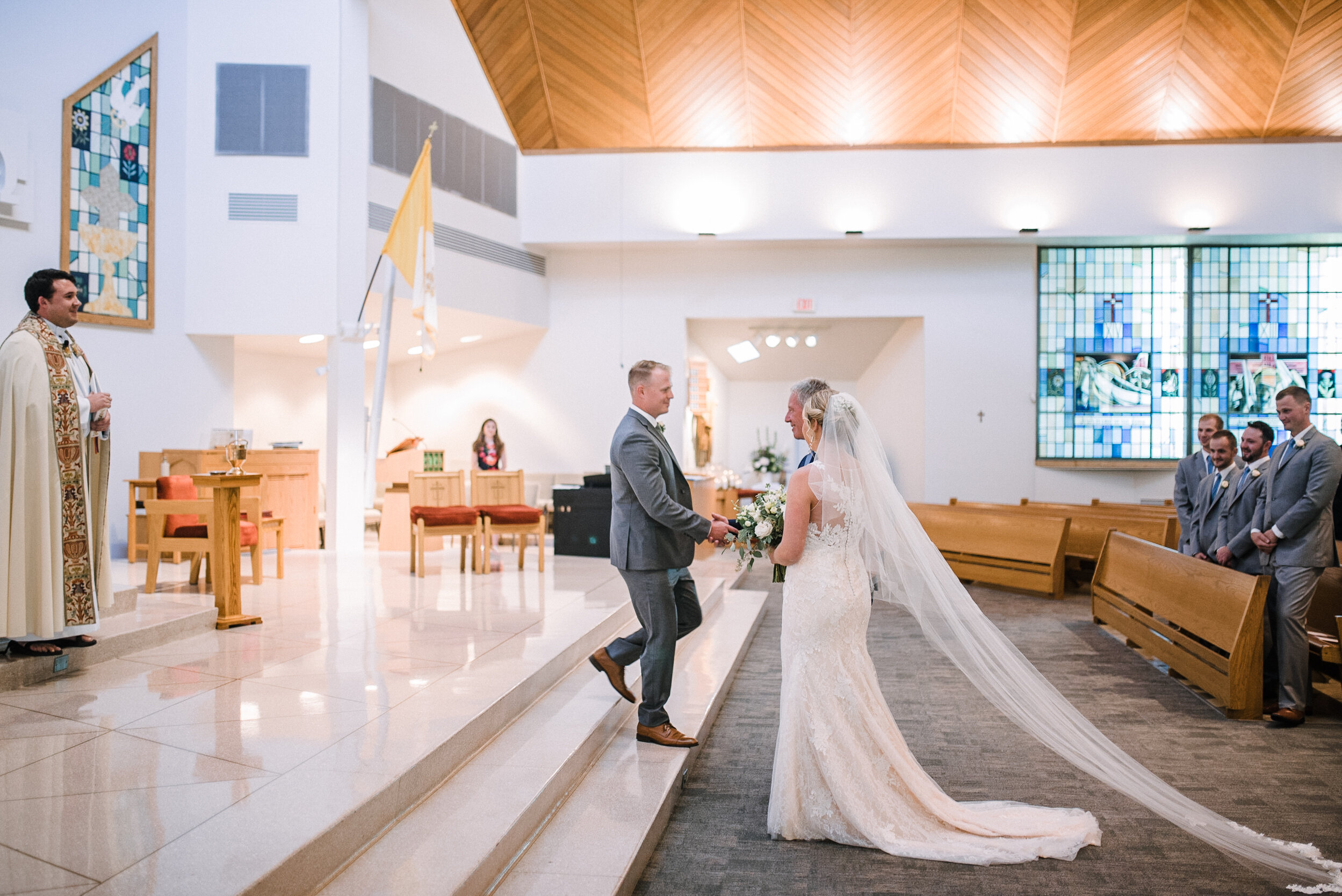 Father of the bride giving bride away at St. Joseph Catholic Church