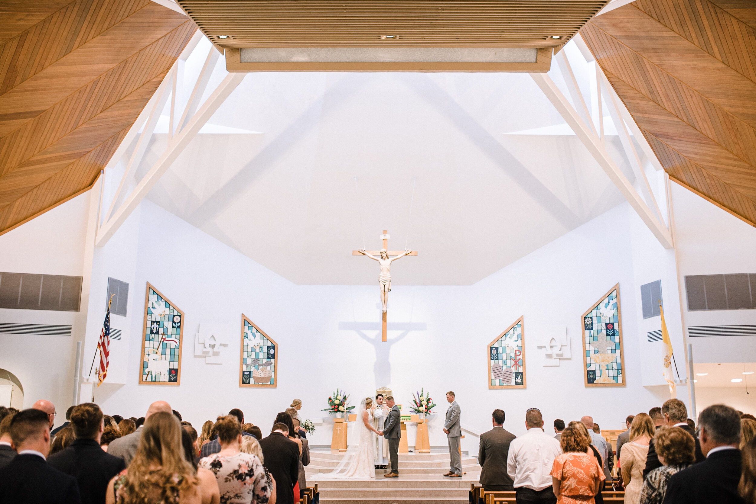 Bride and groom holding hands at the altar at St. Joseph Catholic Church