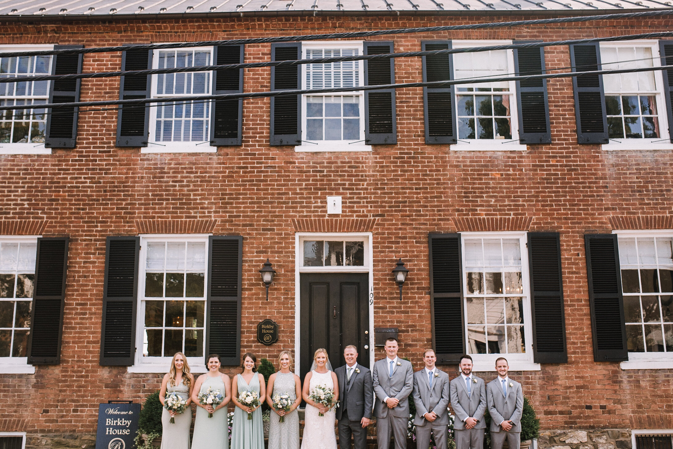 wedding party smiling at Birkby House