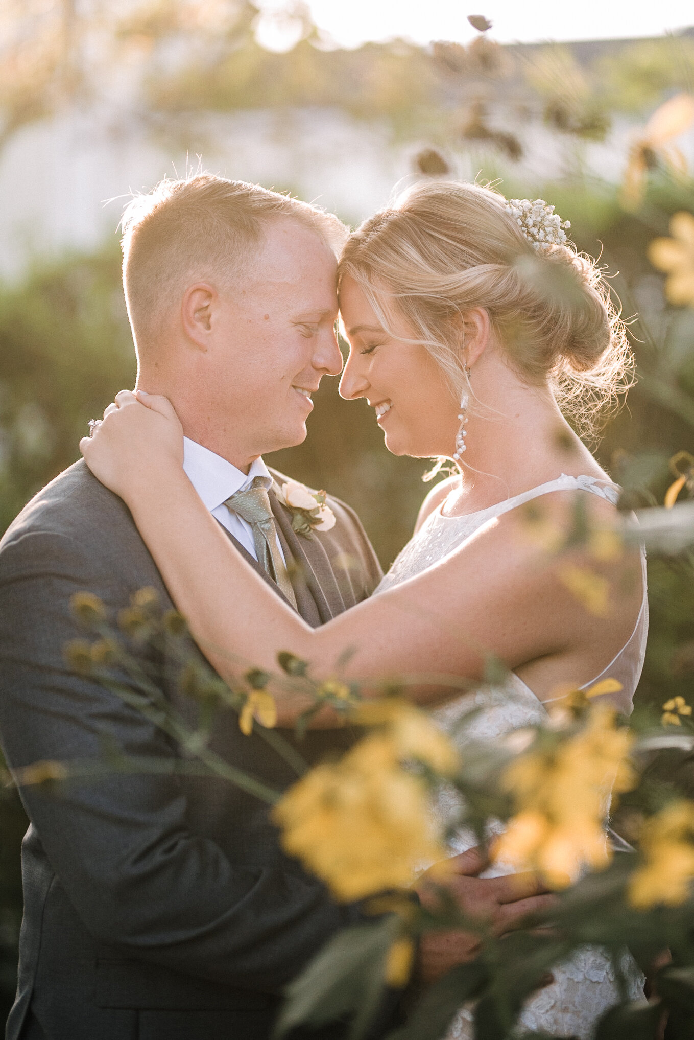 bride and groom embracing at Birkby House
