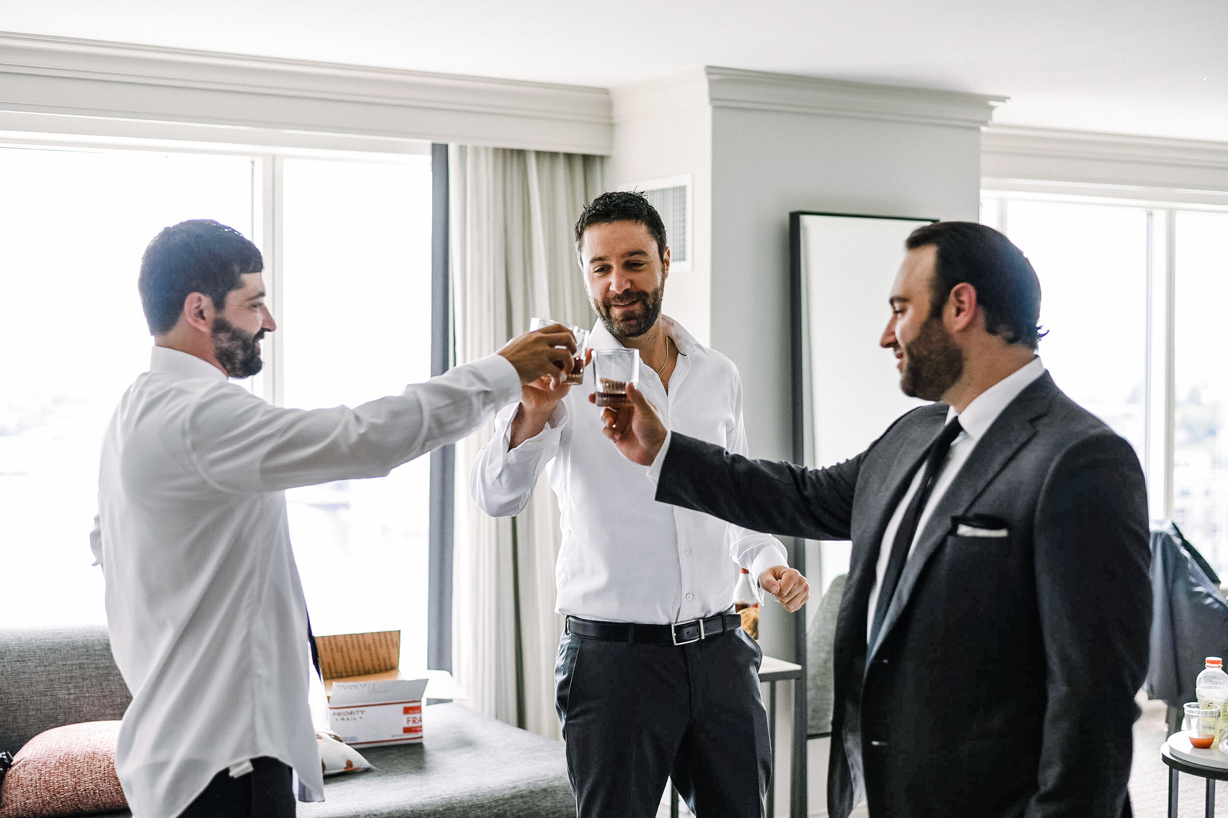 Groom and Groomsmen cheering at The Winslow