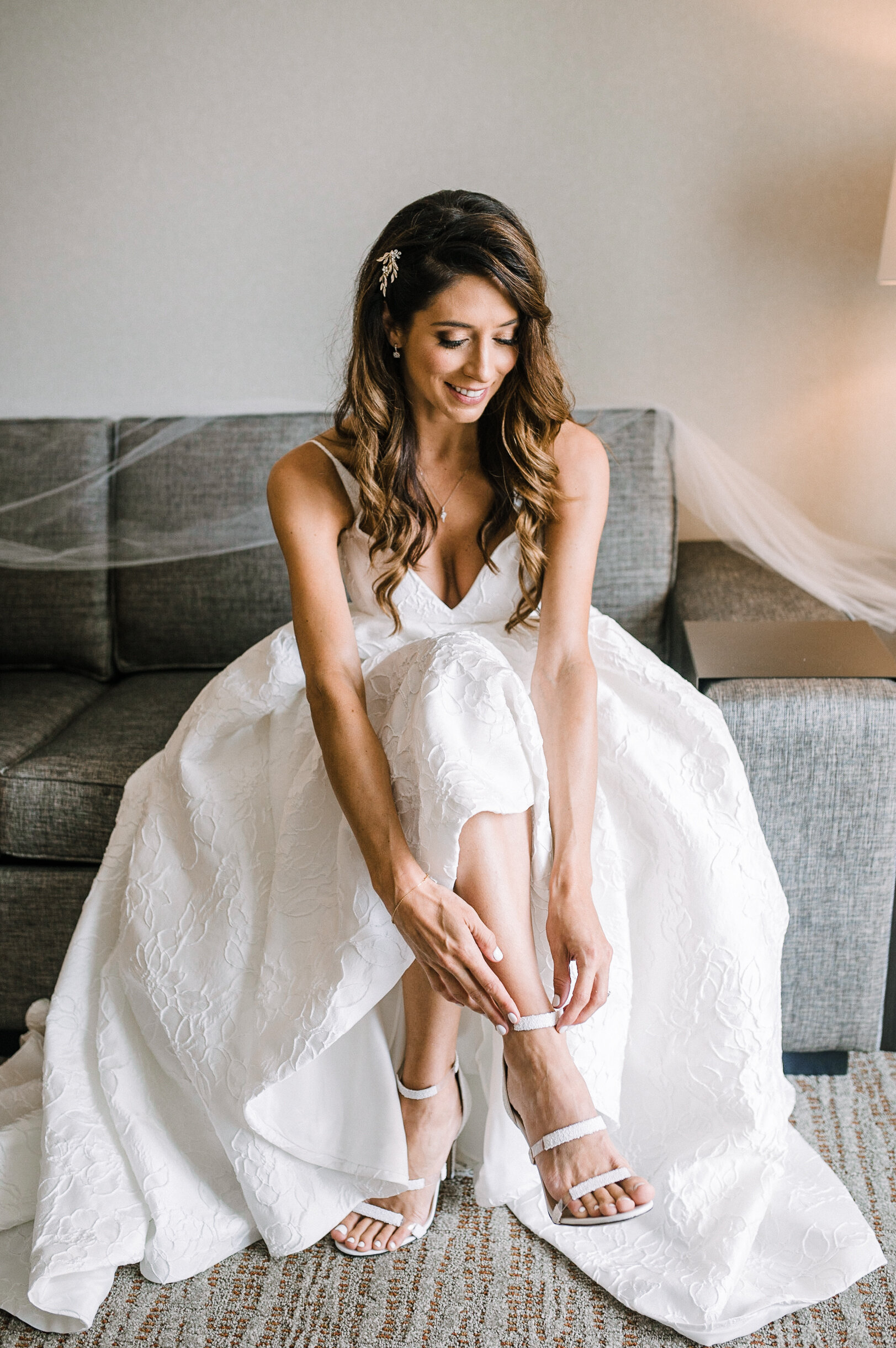 Bride putting on shoes at The Winslow