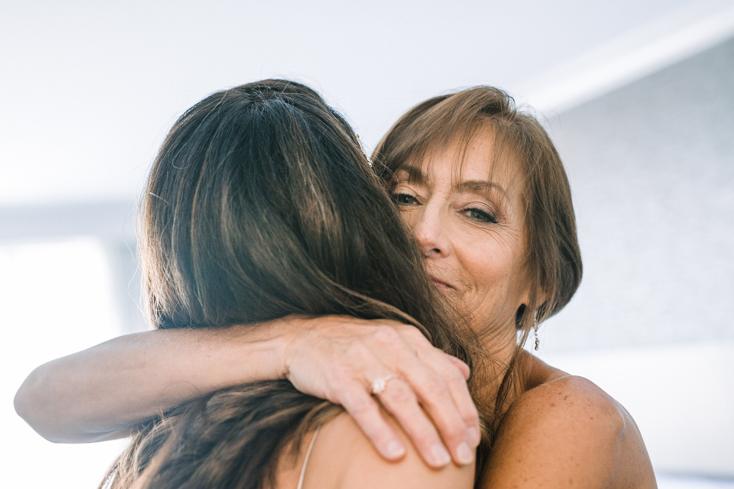 Bride hugging mother at The Winslow
