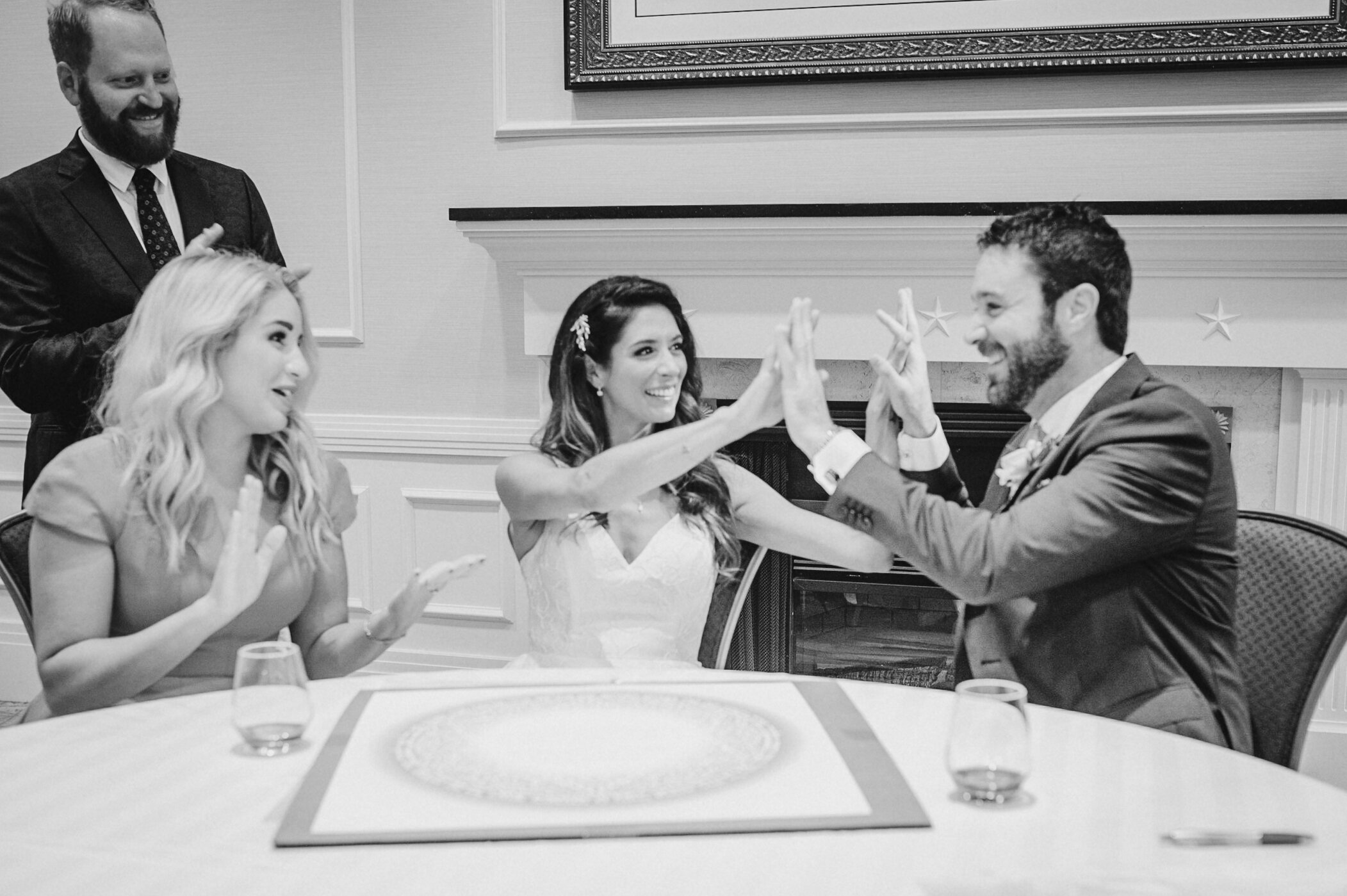 Bride and groom signing ketubah at The Winslow