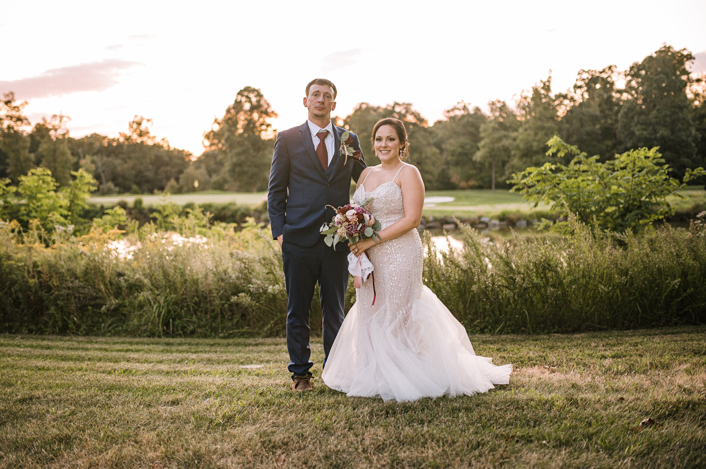 bride and groom smiling at Westfields Golf Club