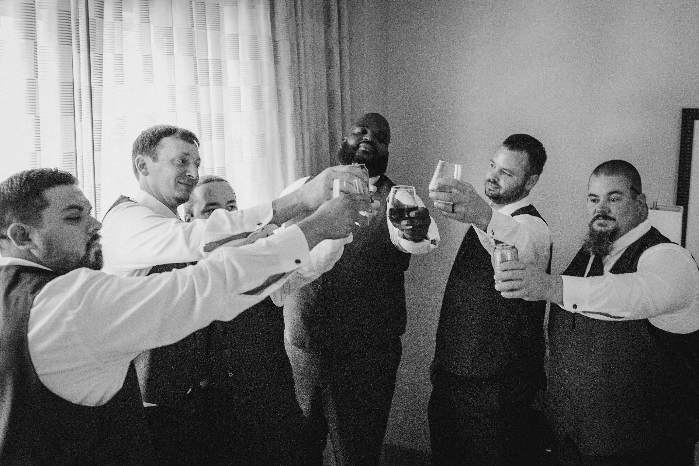 groom and groomsmen cheering at Westfields Golf Club