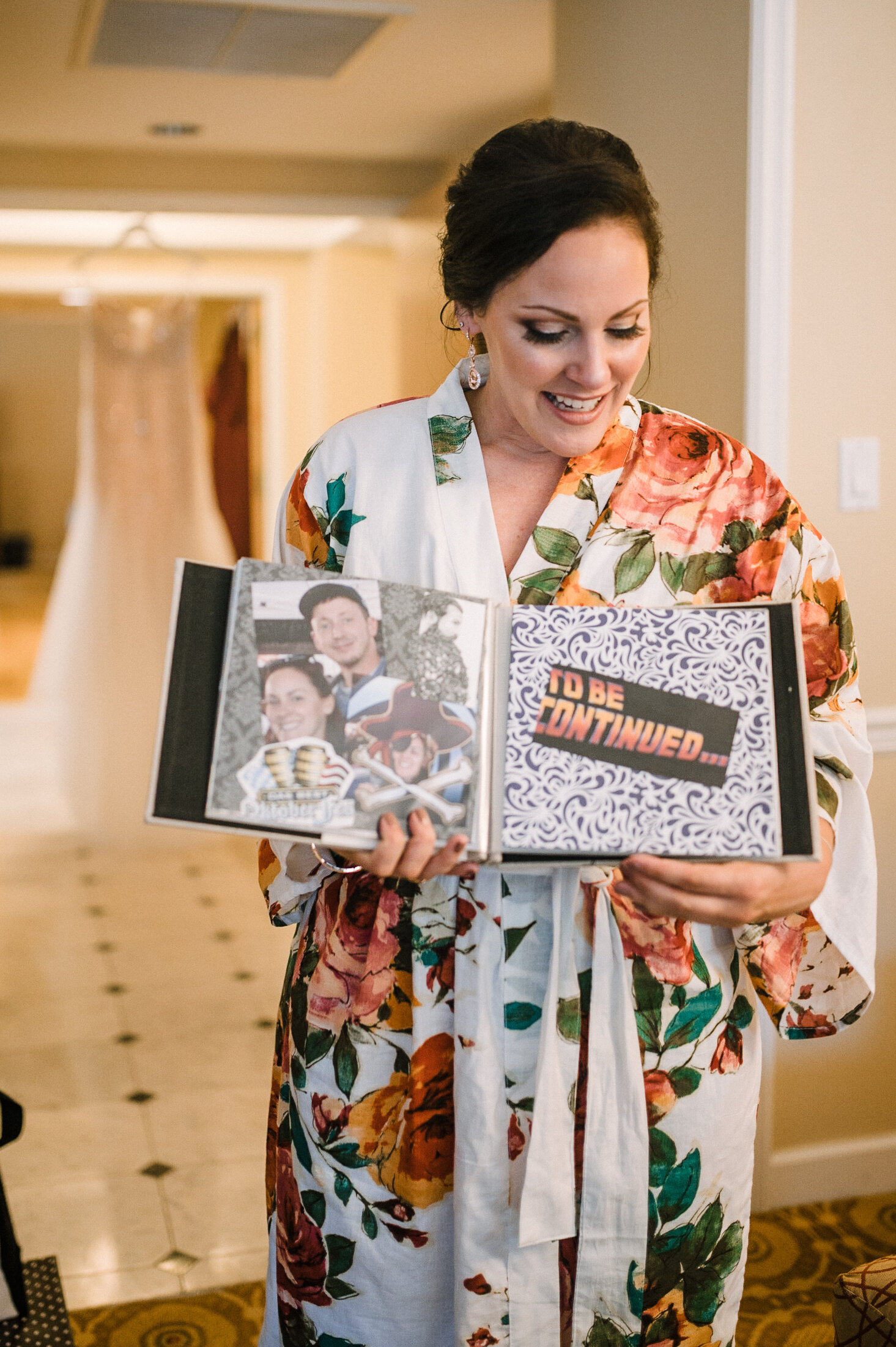 bride opening gift from groom at Westfields Golf Club