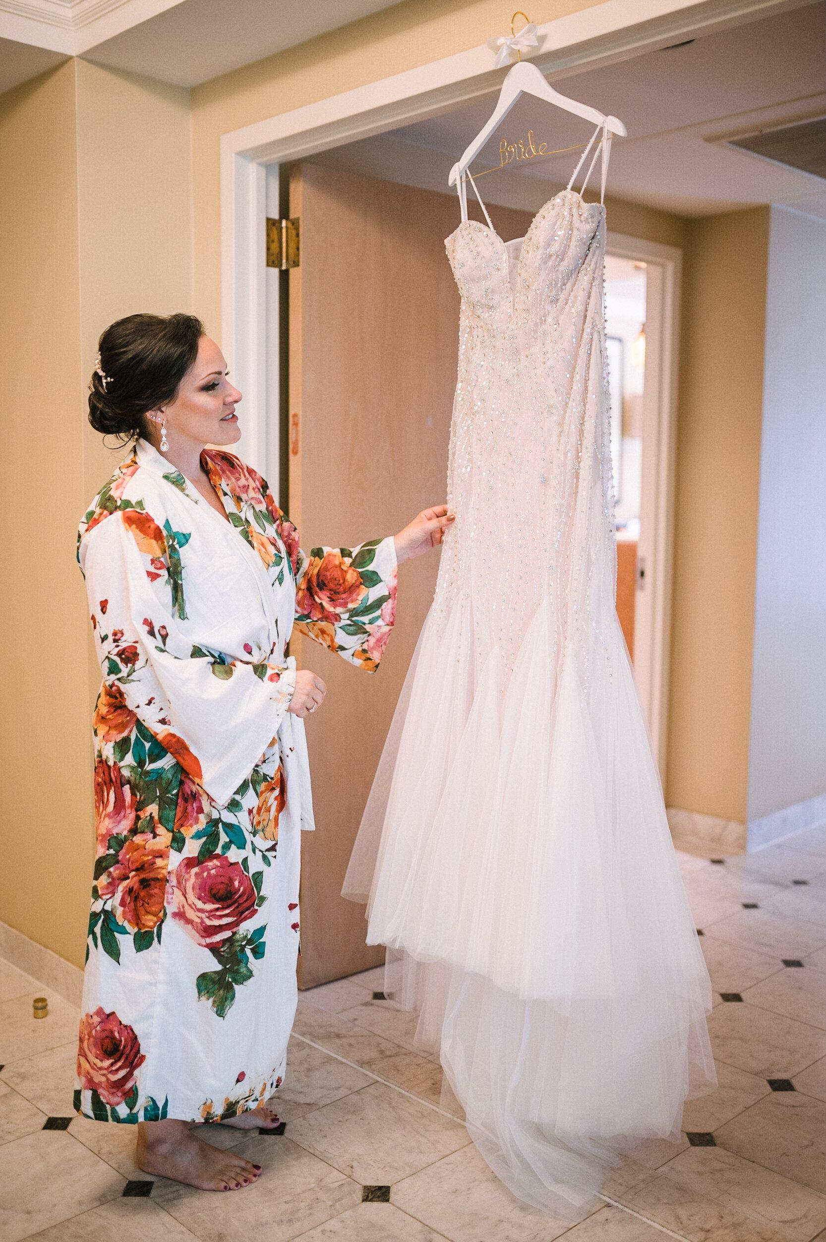 bride admiring her wedding dress at Westfields Golf Club