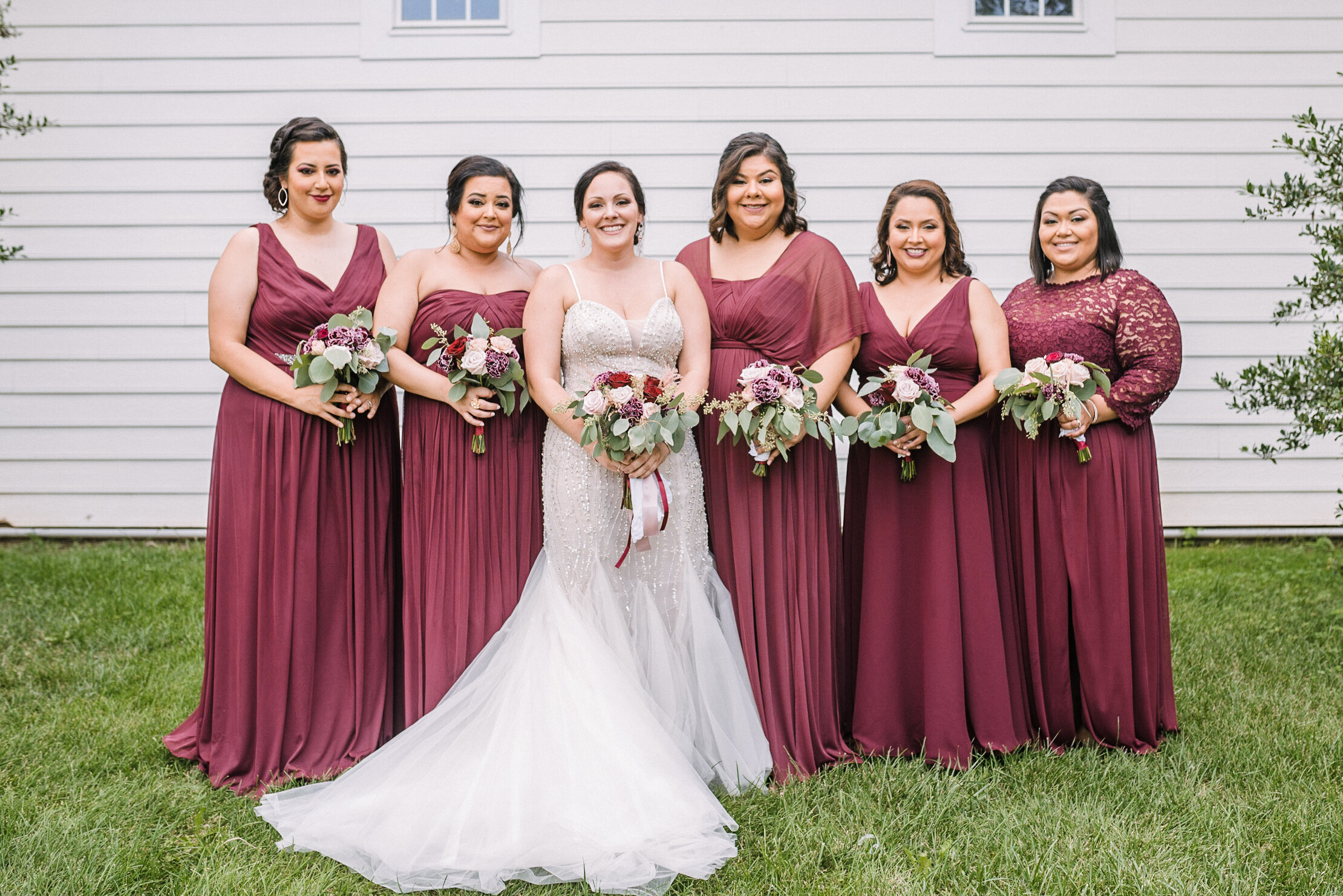 bride and bridesmaids smiling at Westfields Golf Club