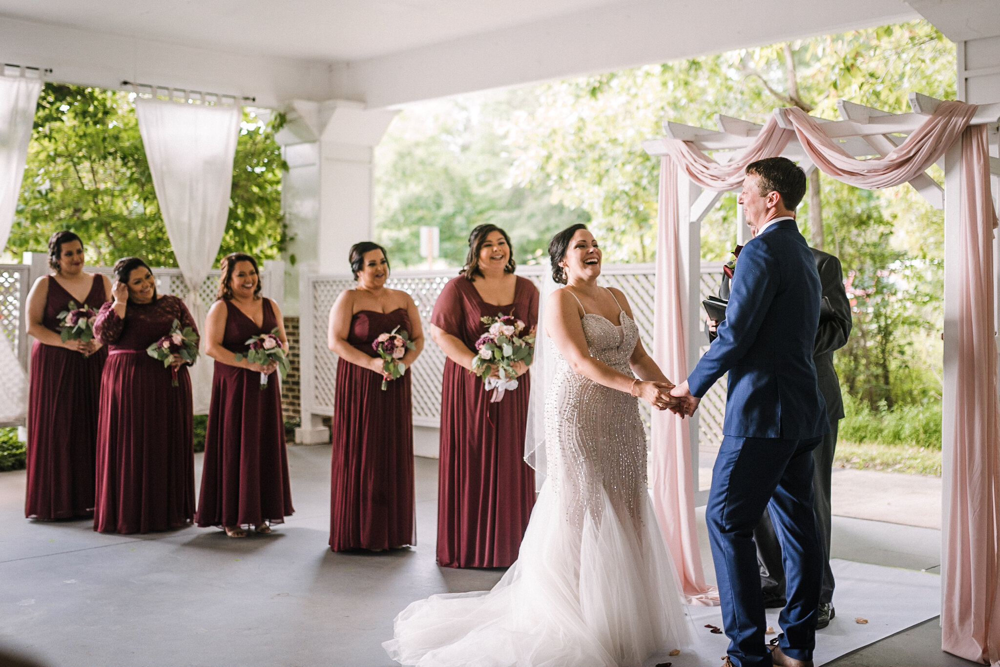 bride laughing during ceremony at Westfields Golf Club