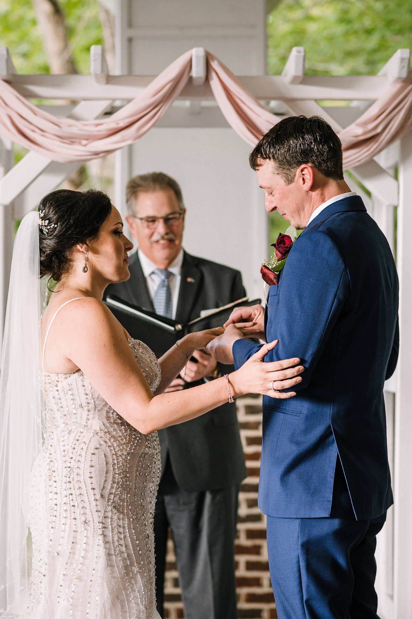 bride and groom exchanging rings at Westfields Golf Club