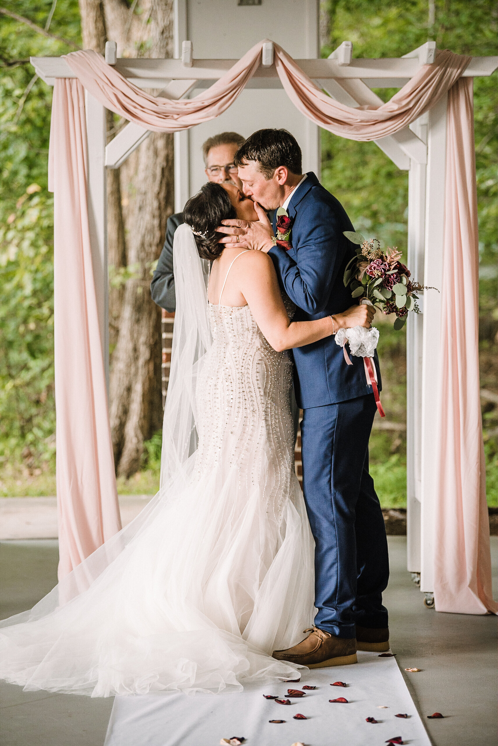 bride and groom kissing during ceremony at Westfields Golf Club