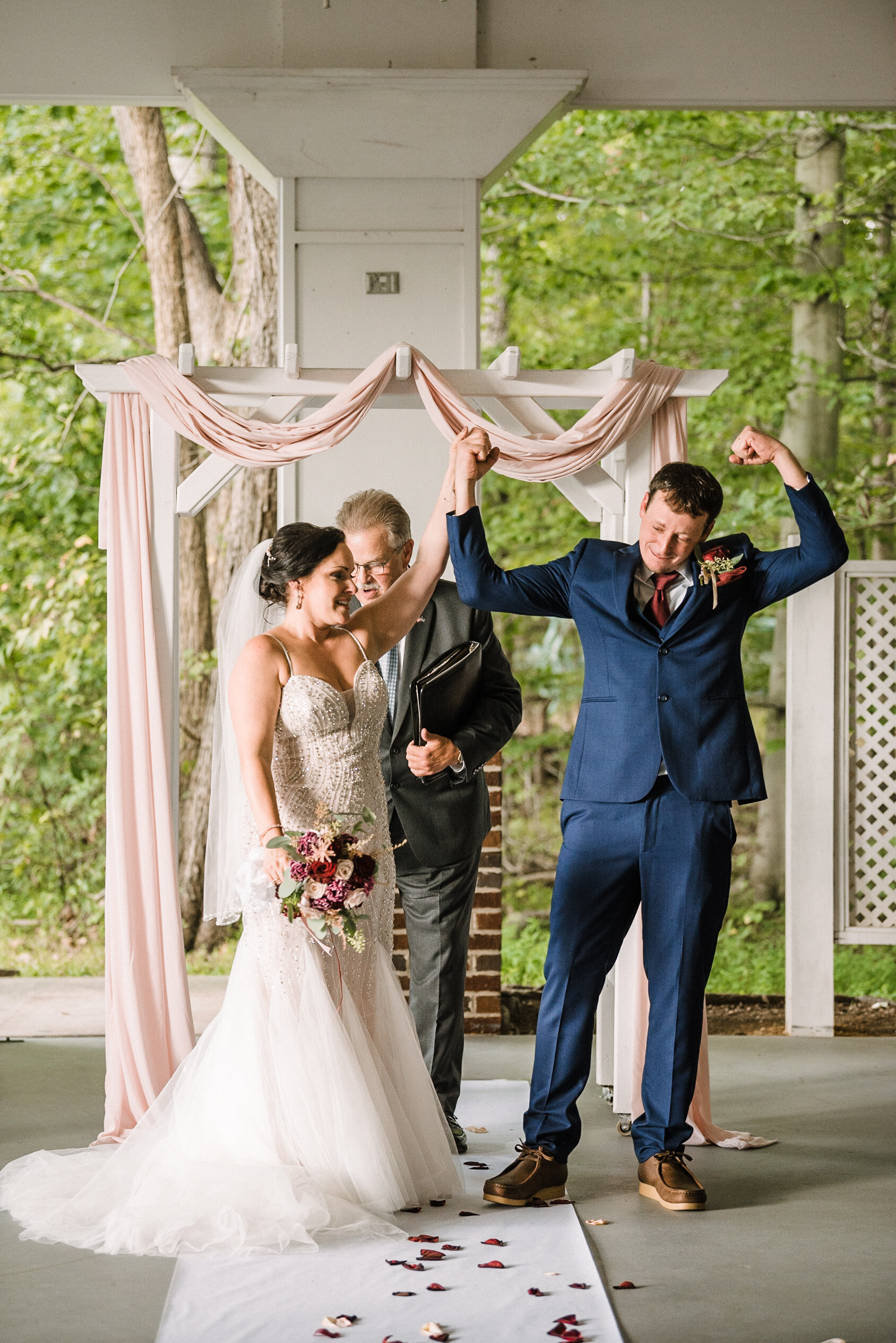 bride and groom cheering after getting married at Westfields Golf Club