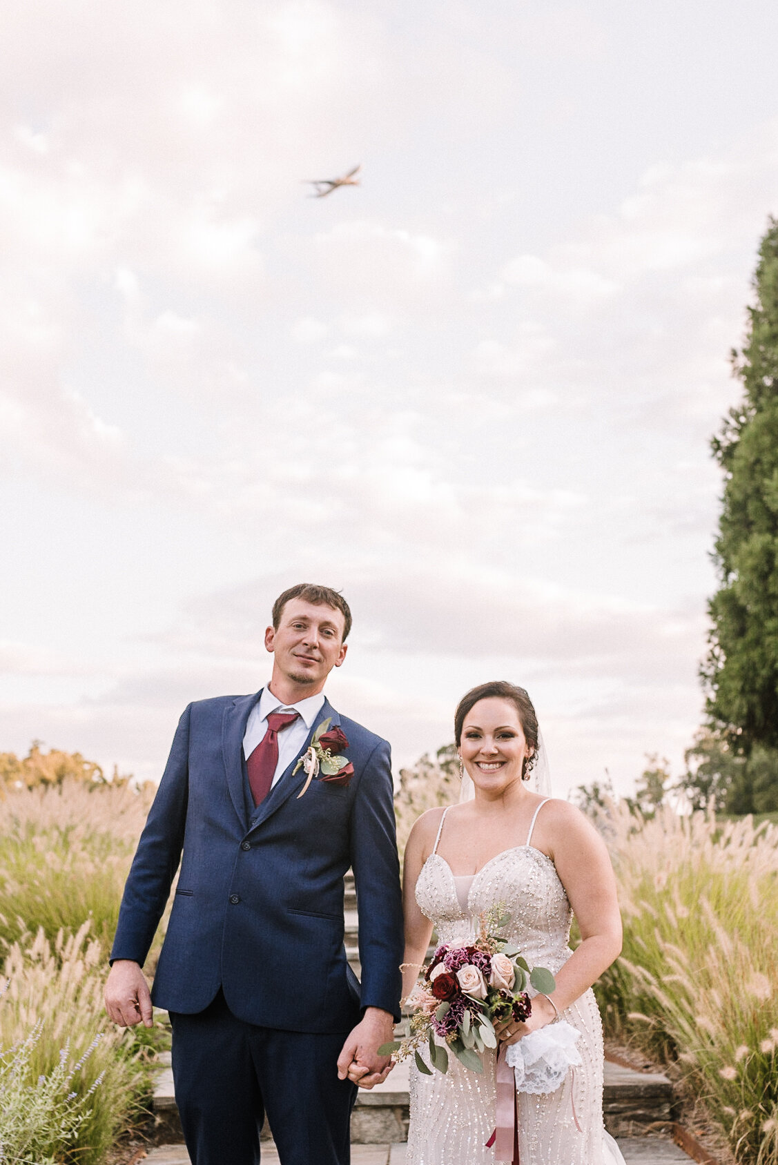bride and groom holding hands at Westfields Golf Club