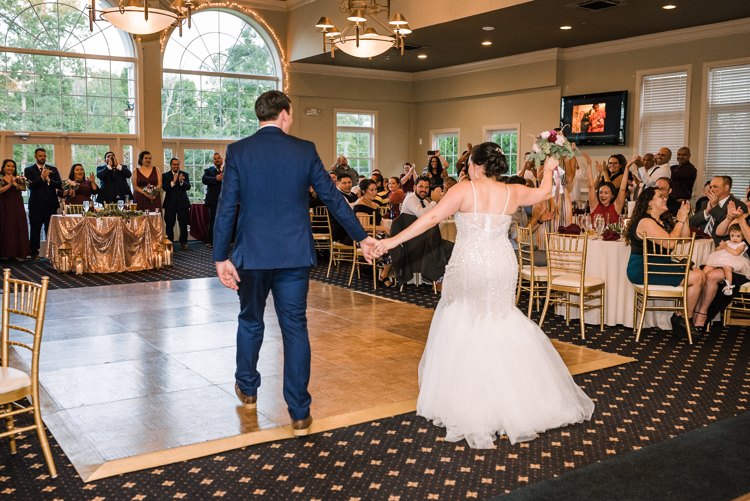 bride and groom entering reception at Westfields Golf Club