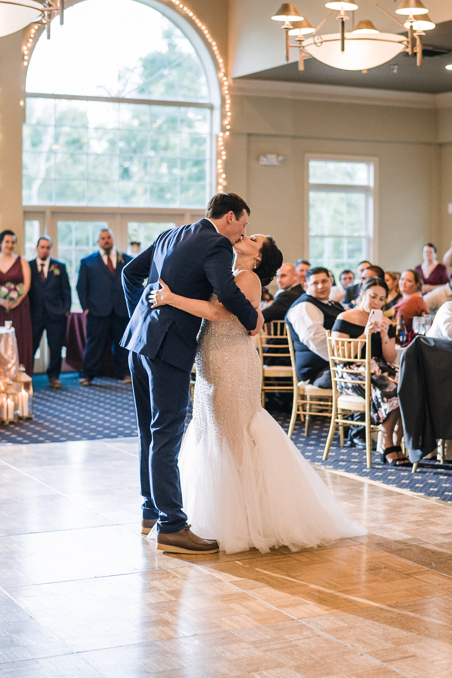bride and groom kissing on the dance floor at Westfields Golf Club