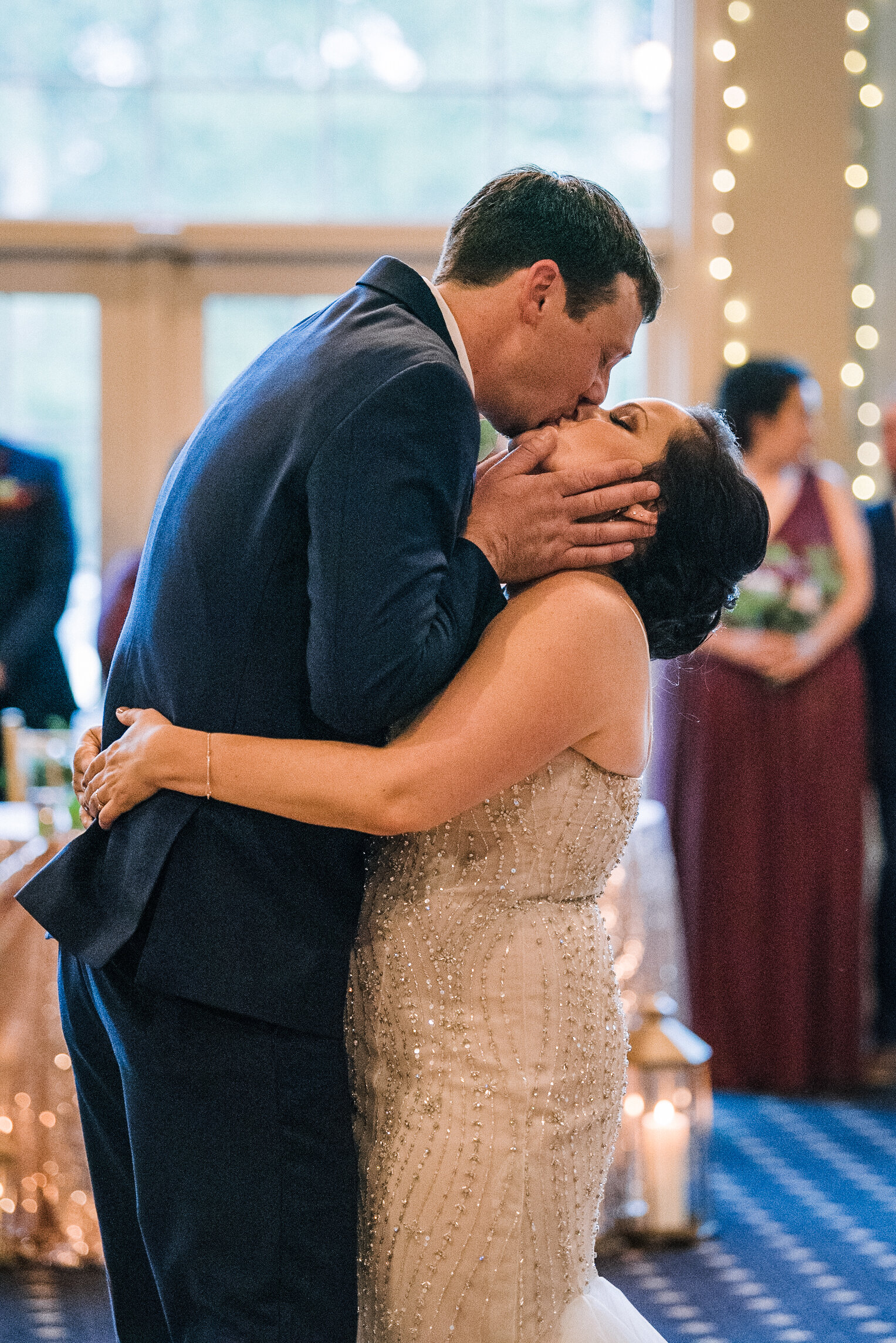 bride and groom kissing on dance floor at Westfields Golf Club