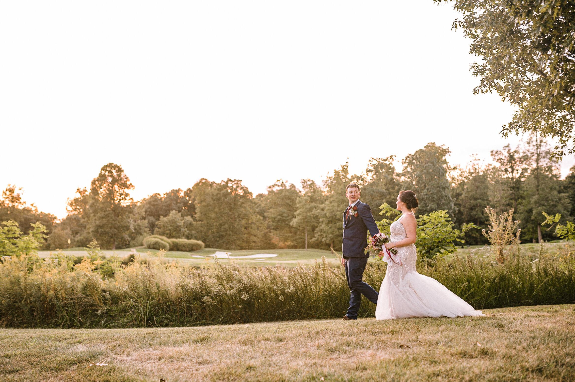 bride and groom walking at Westfields Golf Club