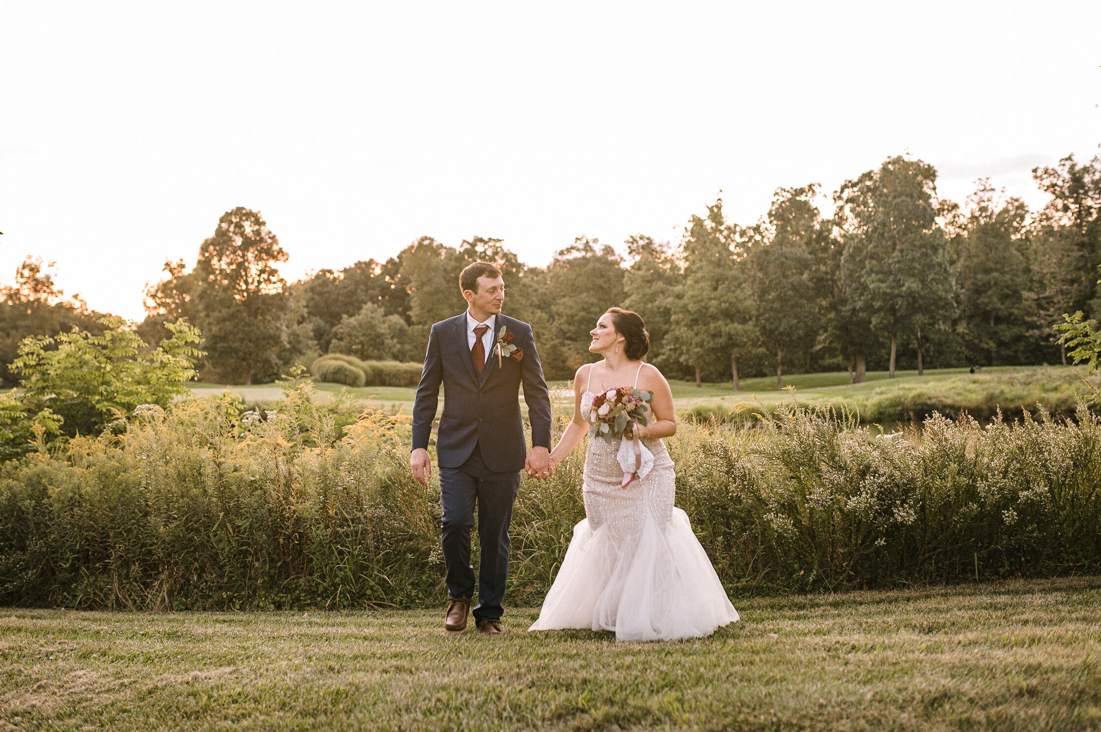 bride holding hands with groom at Westfields Golf Club