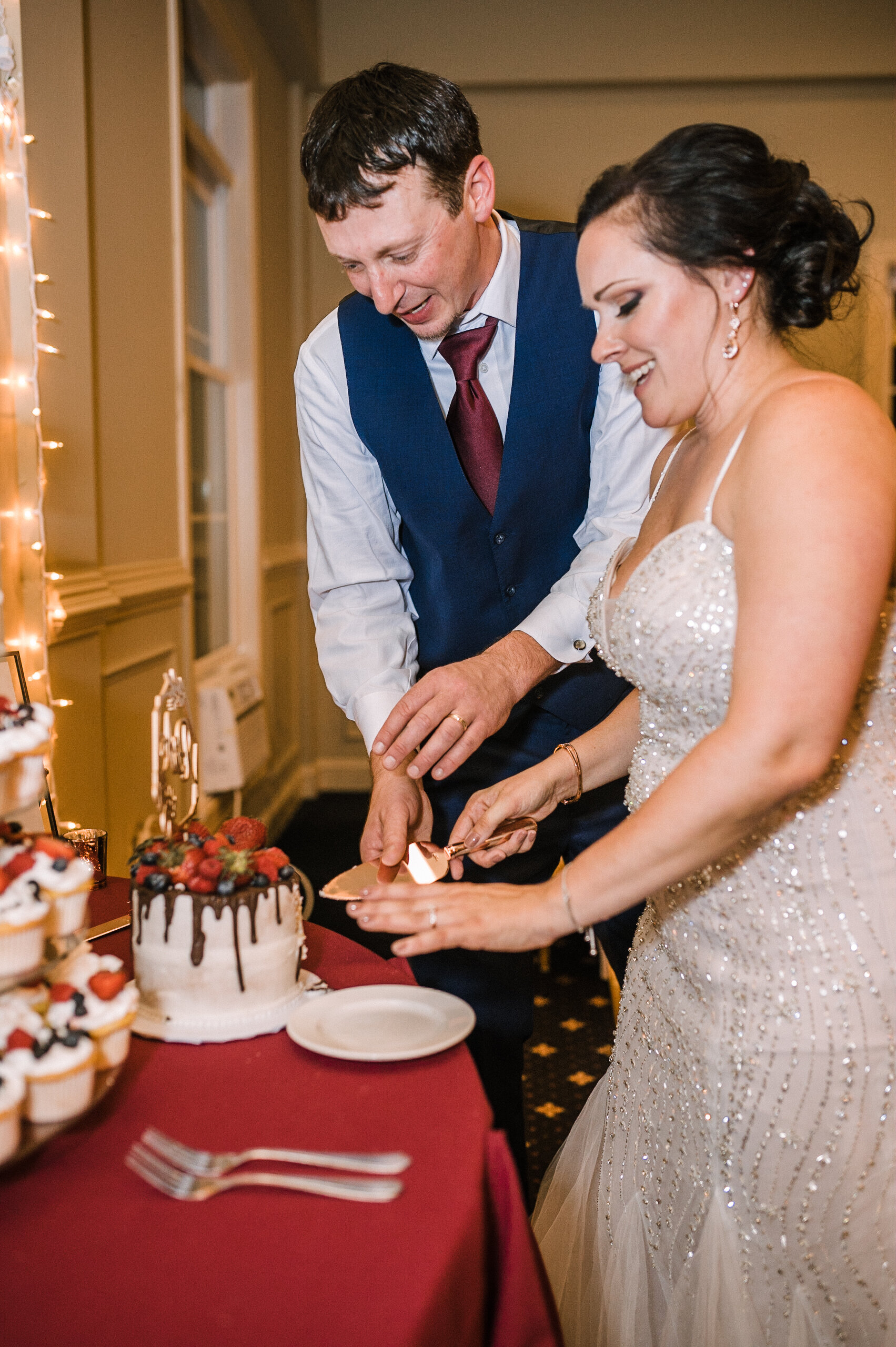 bride and groom cutting wedding cake at Westfields Golf Club