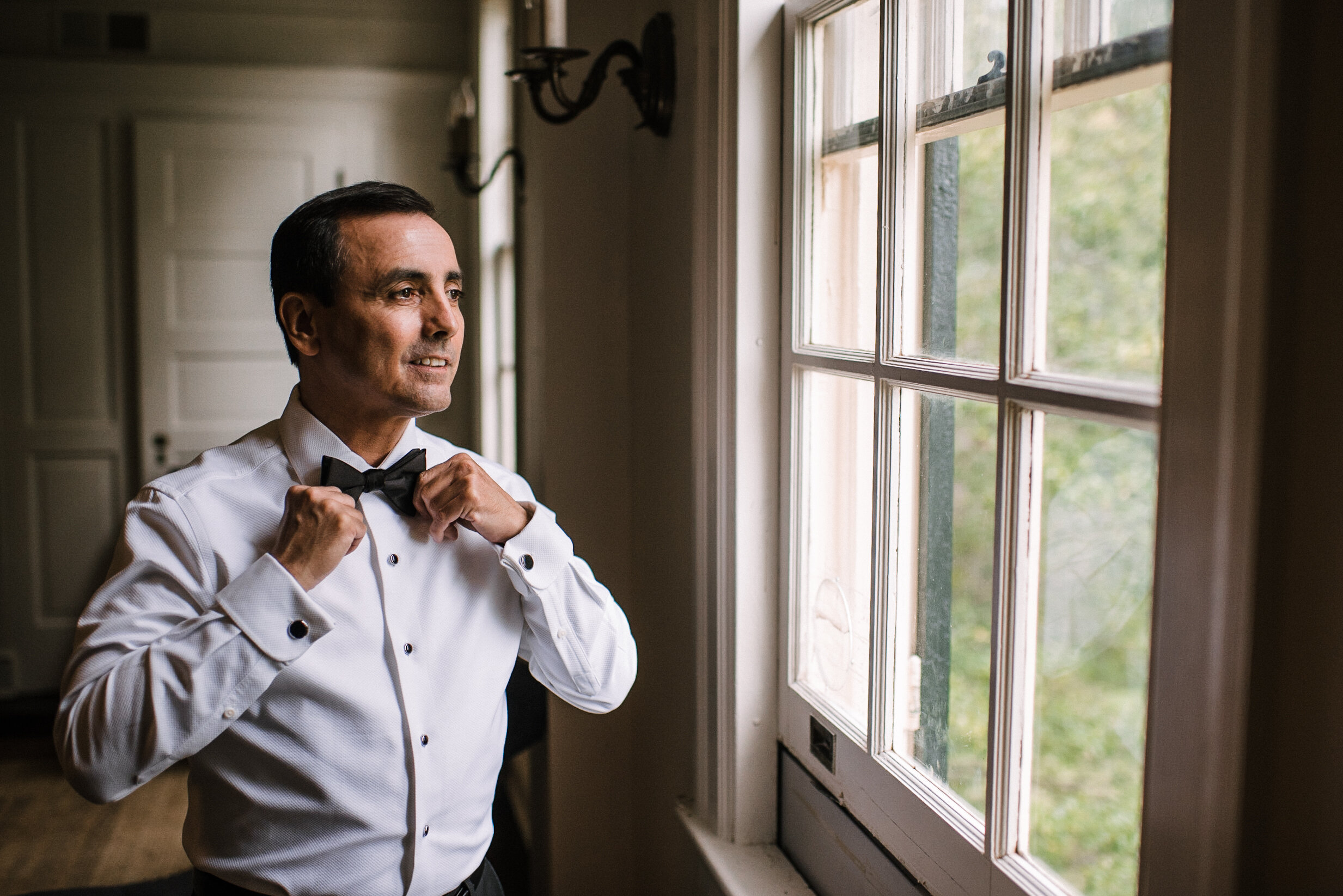 groom getting ready at Rust Manor House
