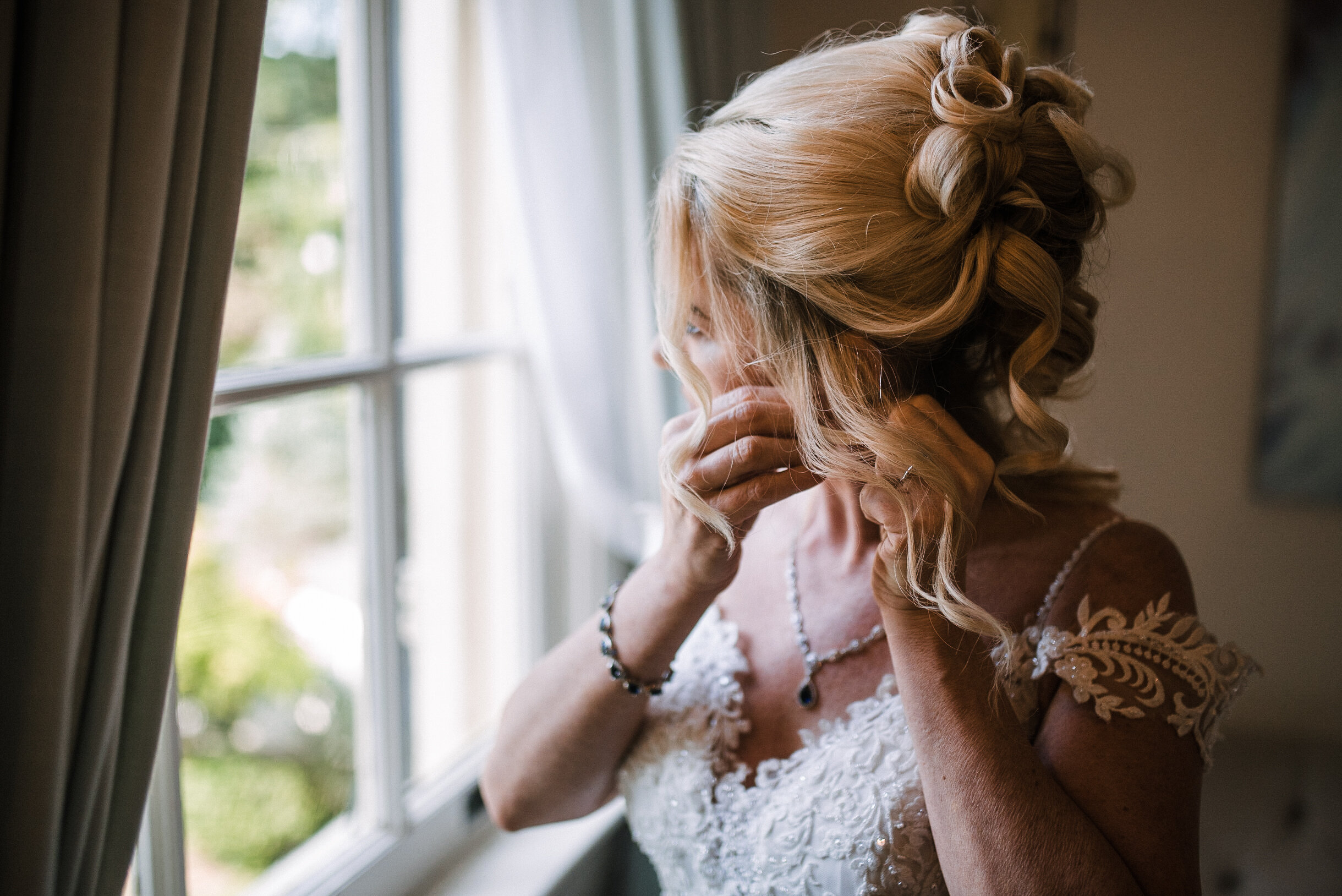 bride getting ready at Rust Manor House