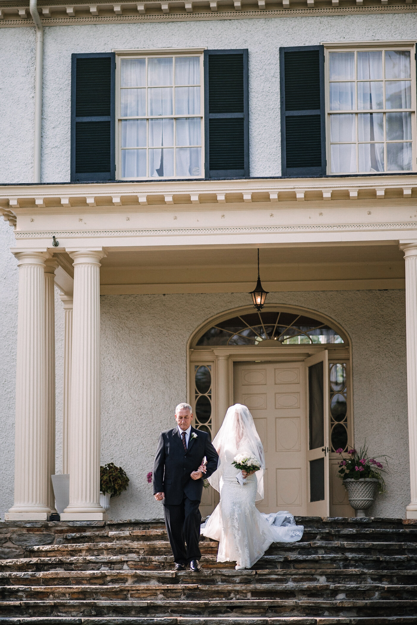 bride coming down the aisle at Rust Manor House