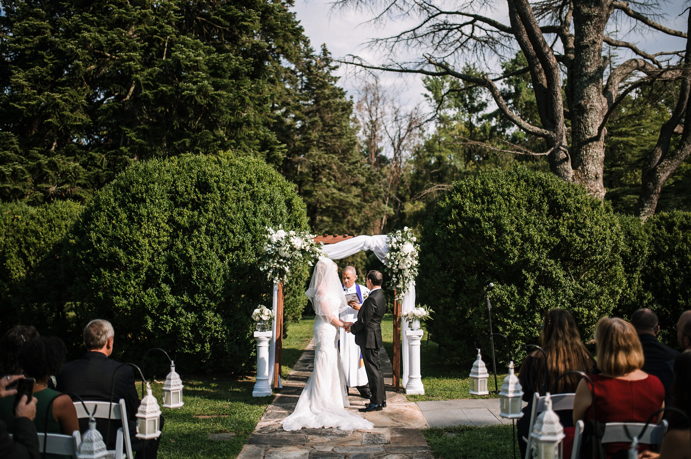 bride and groom holding hands at the altar at Rust Manor House