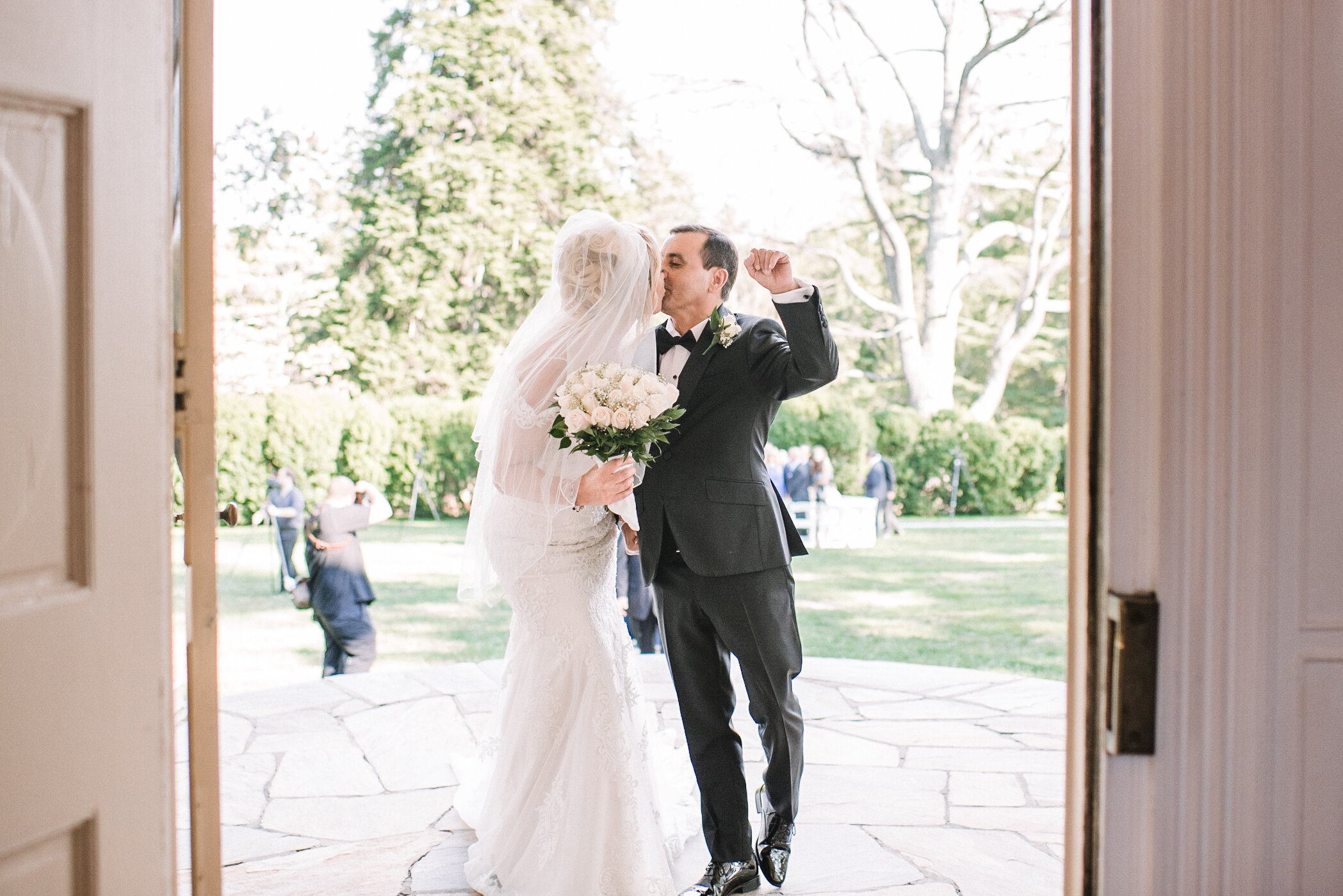 bride and groom kissing after ceremony at Rust Manor House