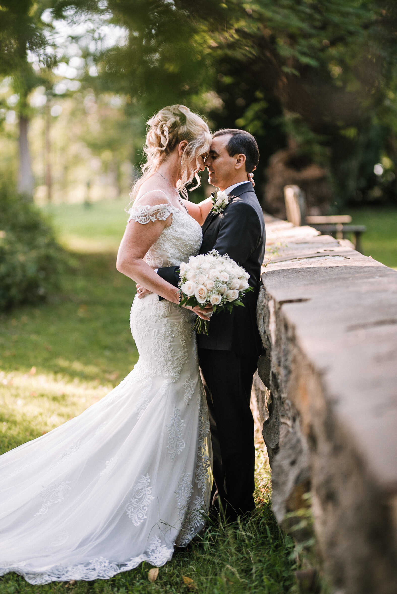 bride and groom embracing at Rust Manor House