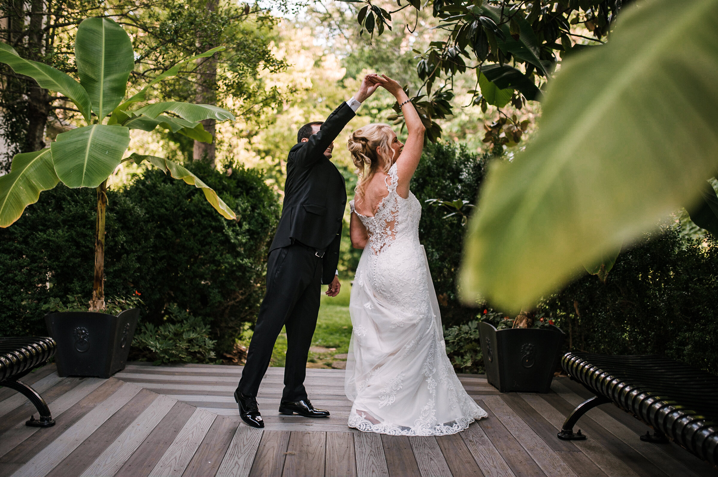 bride and groom doing a twirl at Rust Manor House